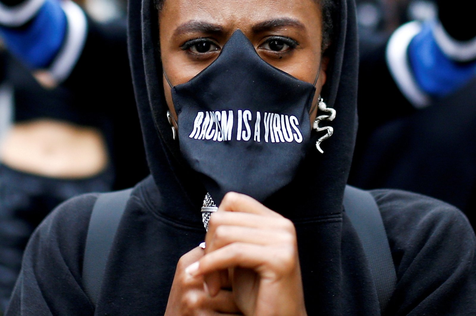 A demonstrator wears a protective mask during a Black Lives Matter protest near Piccadilly Circus in London, Britain, June 29, 2020. (Reuters Photo)