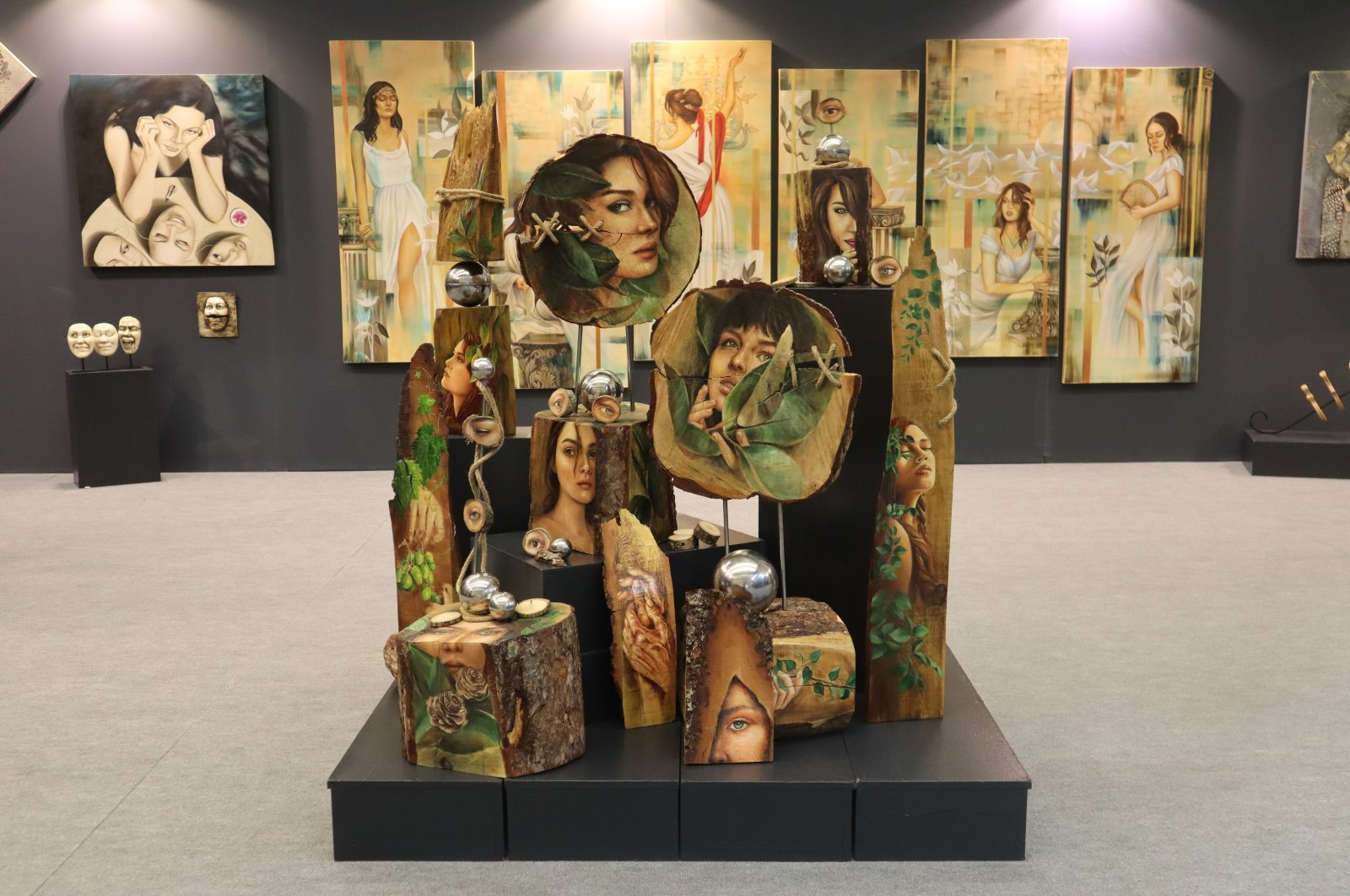 Artworks on women made by female teachers working at the Ankara Metropolitan Municipality are seen in this photo at the contemporary art fair ARTANKARA, Ankara, Turkey, March 30, 2021 (Photo by Dilara Aslan)