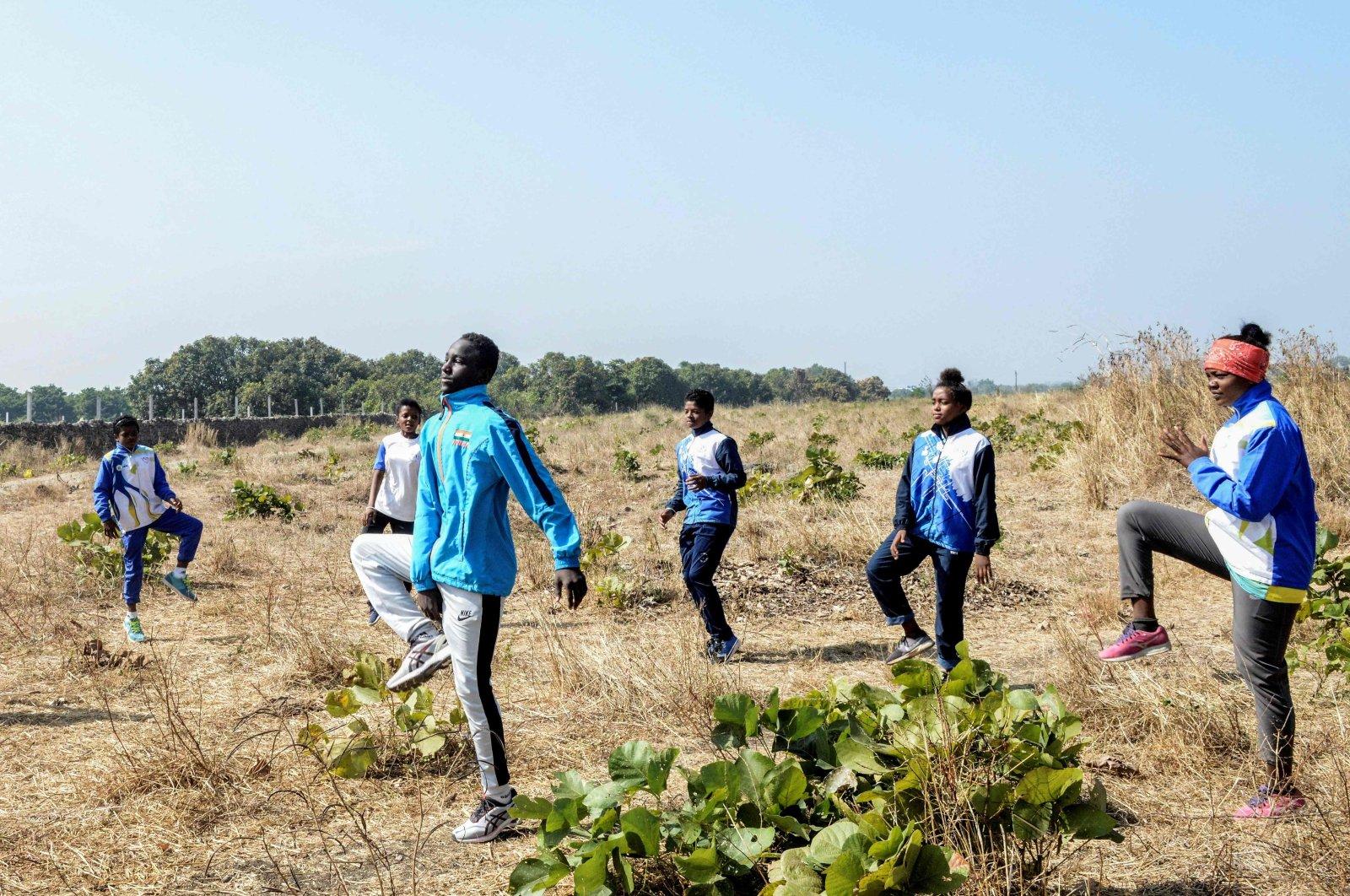 Siddi Youths take part in an exercise routine during an athletes program at Jambur village, in Junagadh district of Gujarat, India, Jan. 6, 2021. (AFP Photo)