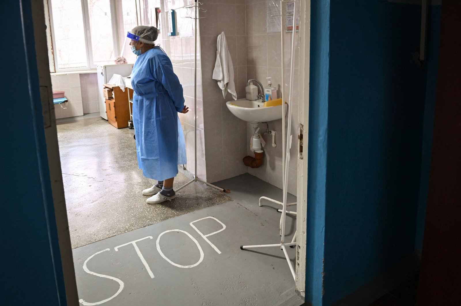 Margaret Melnic, 67, the chief of the COVID-19 section of a regional hospital in Leova city, Moldova, March 23, 2021. (AFP Photo)