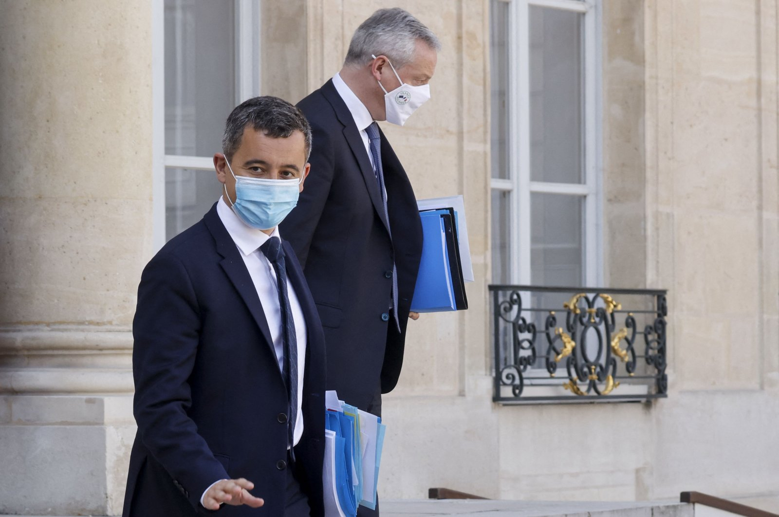 French Interior Minister Gerald Darmanin (L) and French Economy and Finance Minister Bruno Le Maire, wearing protective face masks, leave after a weekly Cabinet meeting at The Elysee Presidential Palace in Paris, France, March 31, 2021. (AFP Photo)