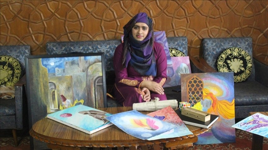 Artist Badarunissa Bhat, 25, poses with some of her artwork at her home in the capital city Srinagar, Kashmir, April 1, 2021. (AA Photo)