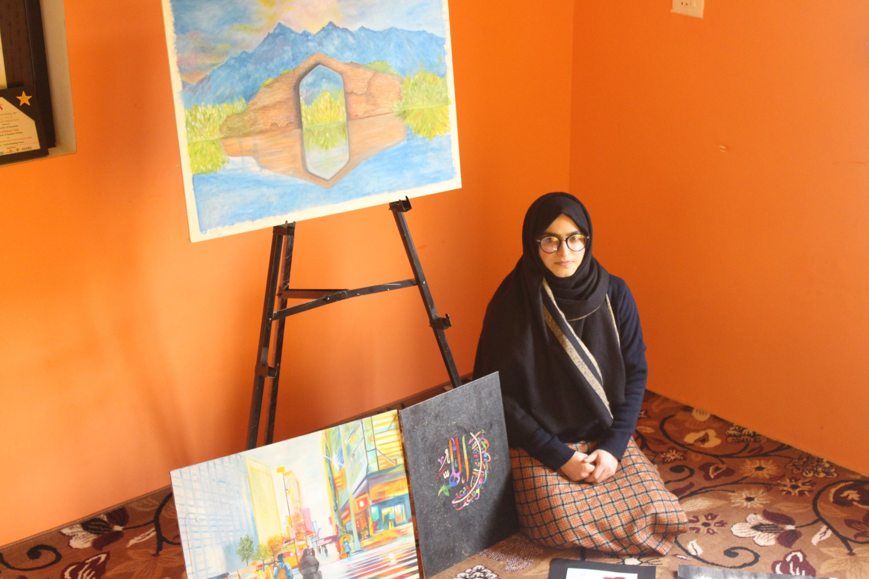 Afifa Makhdoomi poses with her works at her home in Kashmir,  April 1, 2021. (AA Photo)
