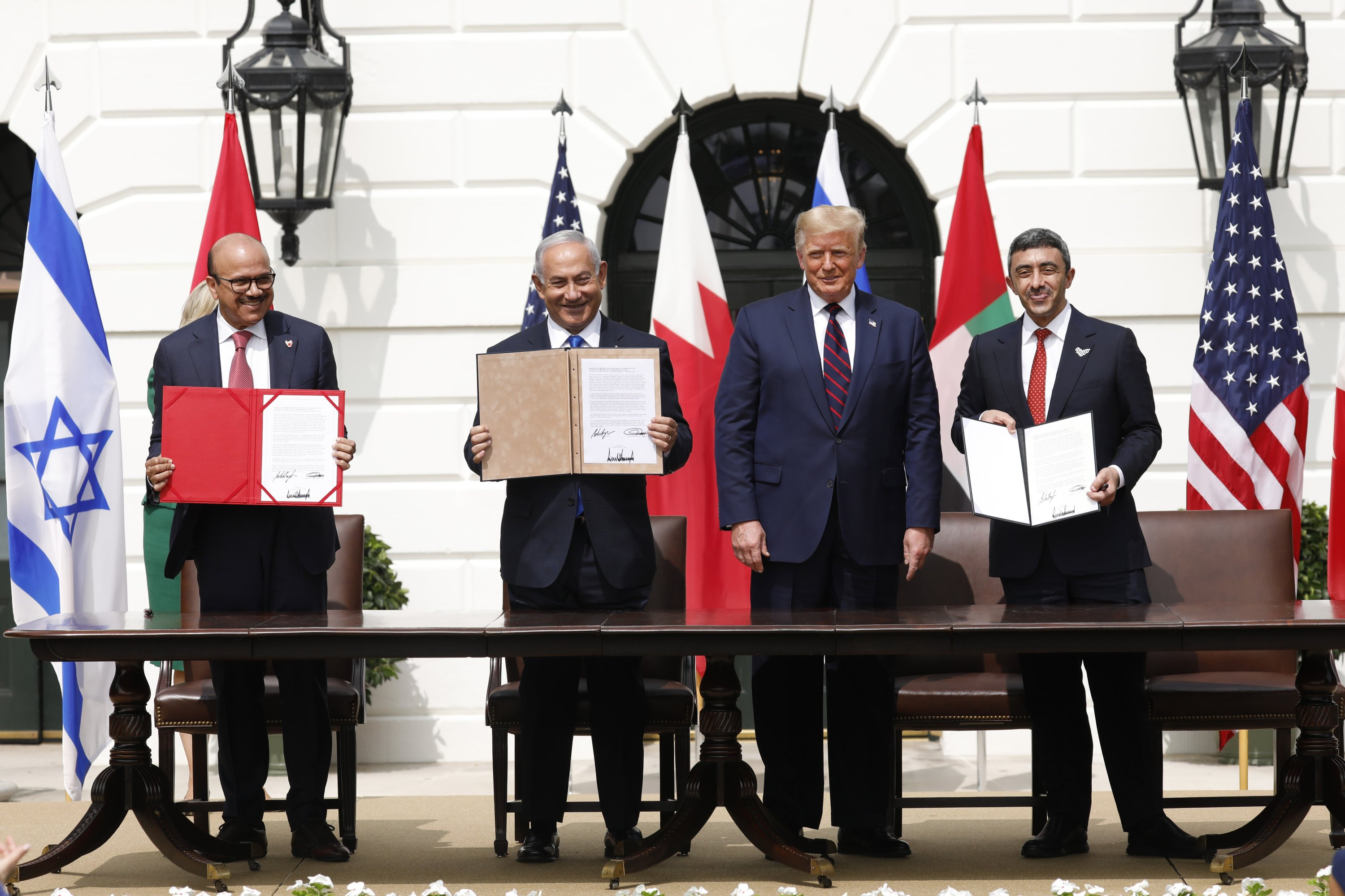 From left to right, Bahrain's Foreign Minister Abdullatif bin Rashid Al Zayani, Israel's Prime Minister Benjamin Netanyahu, then-U.S. President Donald Trump, UAE Foreign Minister Abdullah bin Zayed Al Nahyan hold signed documents during an Abraham Accords signing ceremony event on the South Lawn of the White House, Washington, D.C., U.S., Sept. 15, 2020. (Photo by Getty Images)
