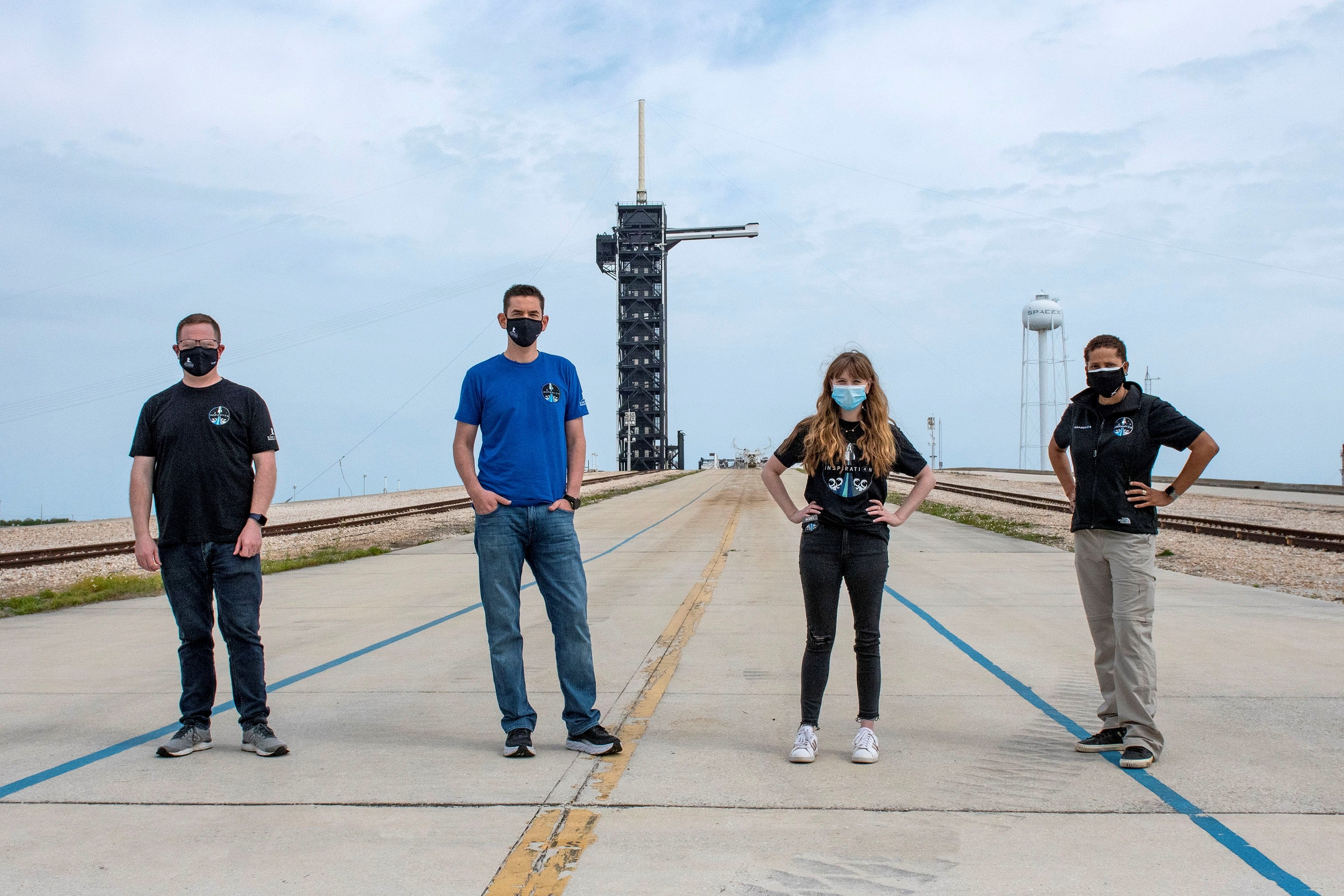 Jared Isaacman, Hayley Arceneaux, Sian Proctor and Chris Sembroski pose for a photo at the SpaceX launch tower at NASA's Kennedy Space Center at Cape Canaveral, Florida U.S., March 29, 2021 in this handout image provided by SpaceX. (Inspiration 4/Handout via REUTERS)