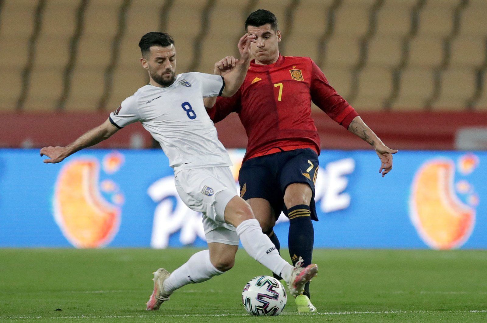 Spain's striker Alvaro Morata (R) duels for the ball against Kosovo's midfielder Besar Halimi (L) during their FIFA World Cup 2022 Qualifying round, Group B match at La Cartuja stadium, in Seville, Andalusia, Spain, March 31, 2021. (EPA Photo)