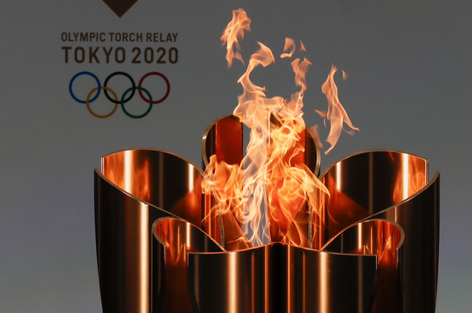 The celebration cauldron is seen lit on the first day of the Tokyo 2020 Olympic torch relay in Naraha, Fukushima prefecture, northeastern Japan, March 25, 2021. (AP Photo)