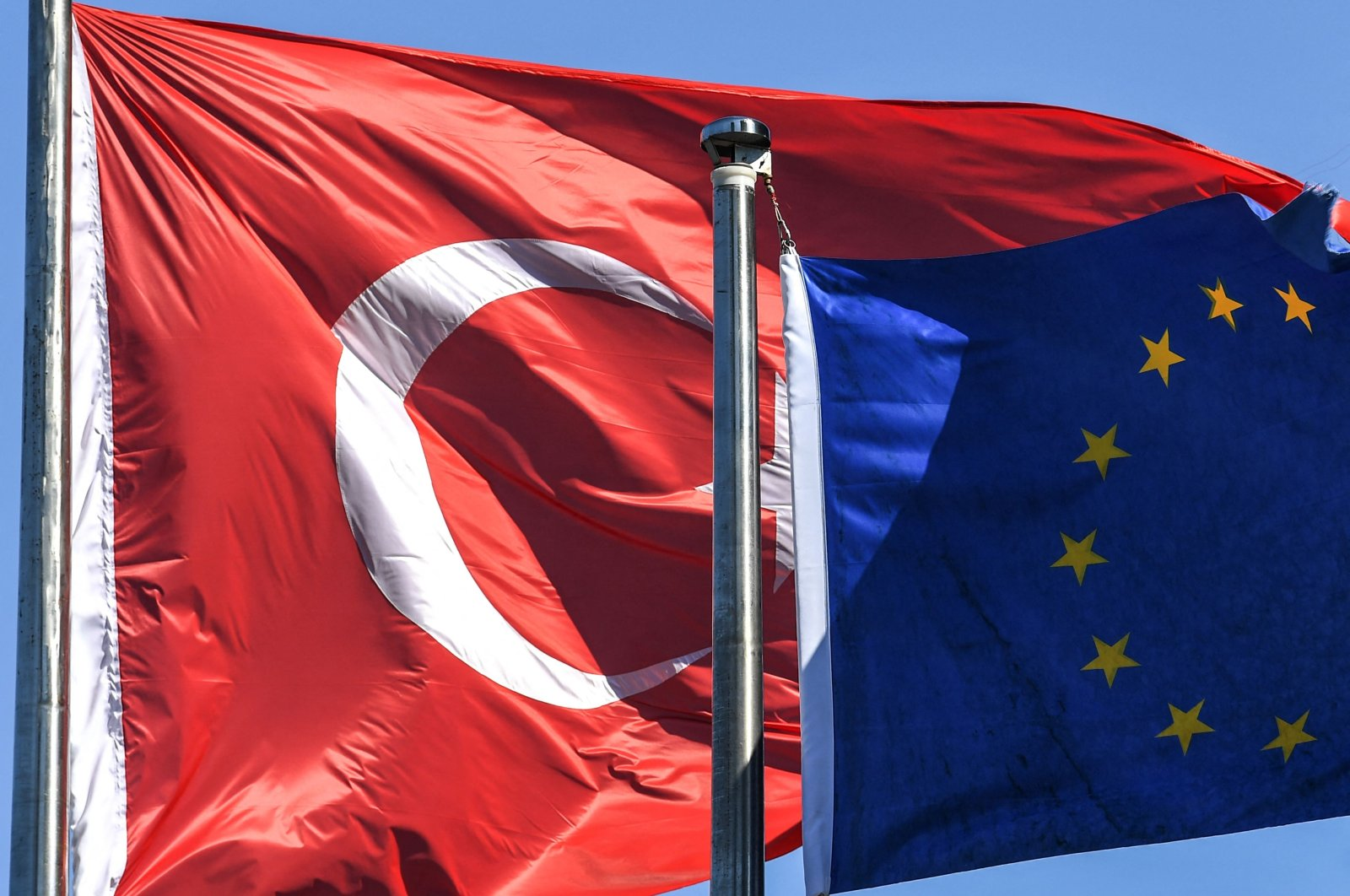 The Turkish flag and European Union flag flutter in the wind in the Maslak financial and business district in Istanbul, Turkey, Aug. 15, 2018. (AFP Photo)