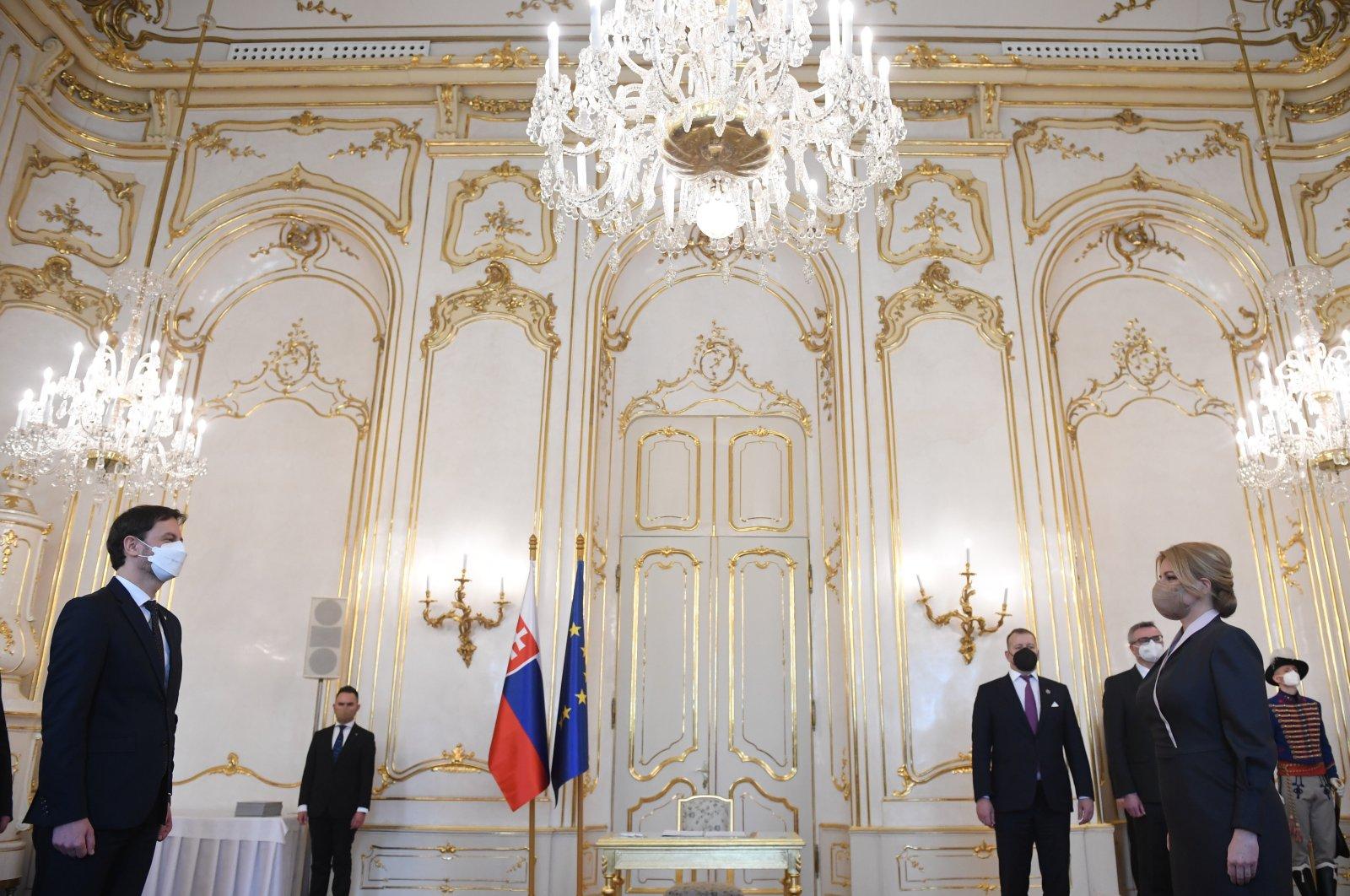 Slovak President Zuzana Caputova (R), appoints members of the new government to be headed by Prime Minister Eduard Heger (L), in Bratislava, Slovakia, April 1, 2021. (AP)