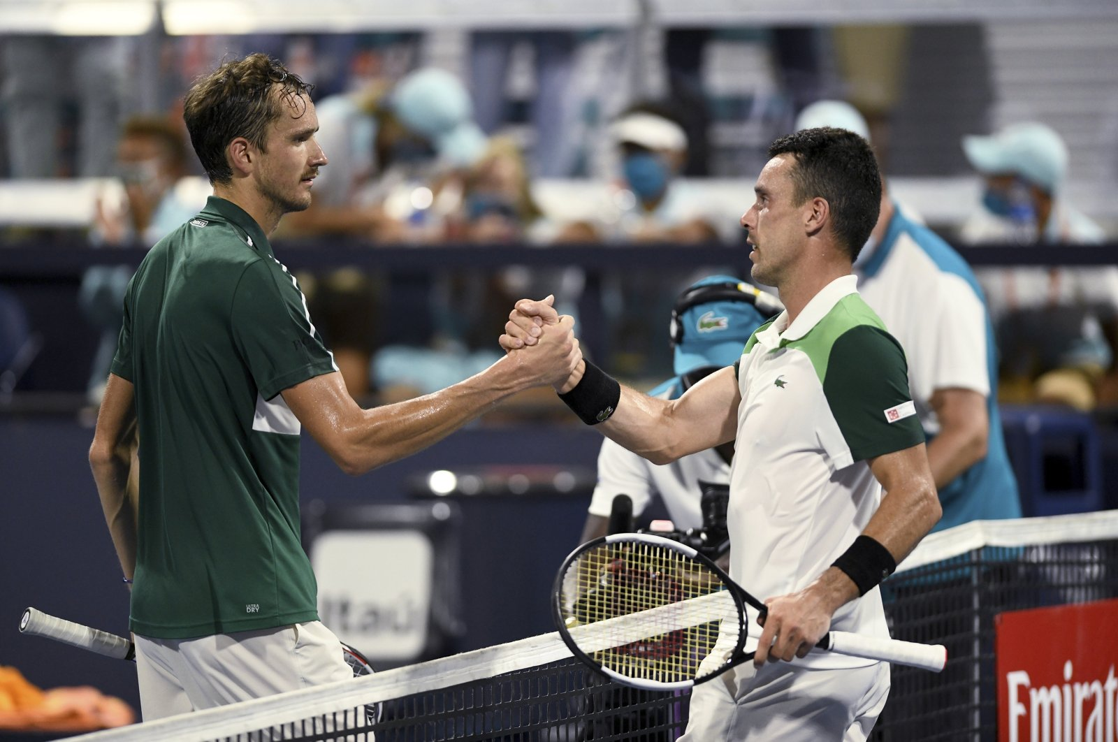 Russia's Daniil Medvedev (L) shakes hands with Spain's Roberto Bautista Agut after a 6-4, 6-2 loss at the Miami Open tennis tournament, in Miami, U.S., March 31, 2021. (AP Photo)