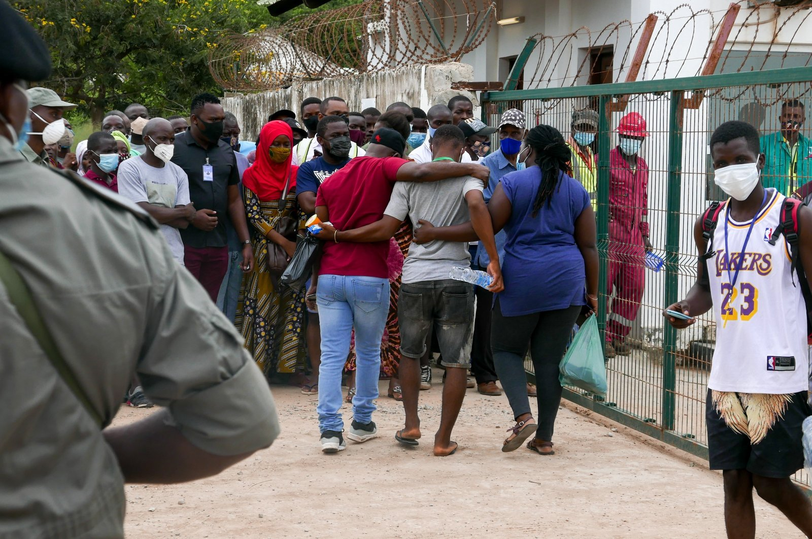 Family members welcome a displaced relative arriving at the port of Pemba on a boat carrying 1200 displaced people from Palma, in Pemba, Mozambique, April 1, 2021. (EPA)