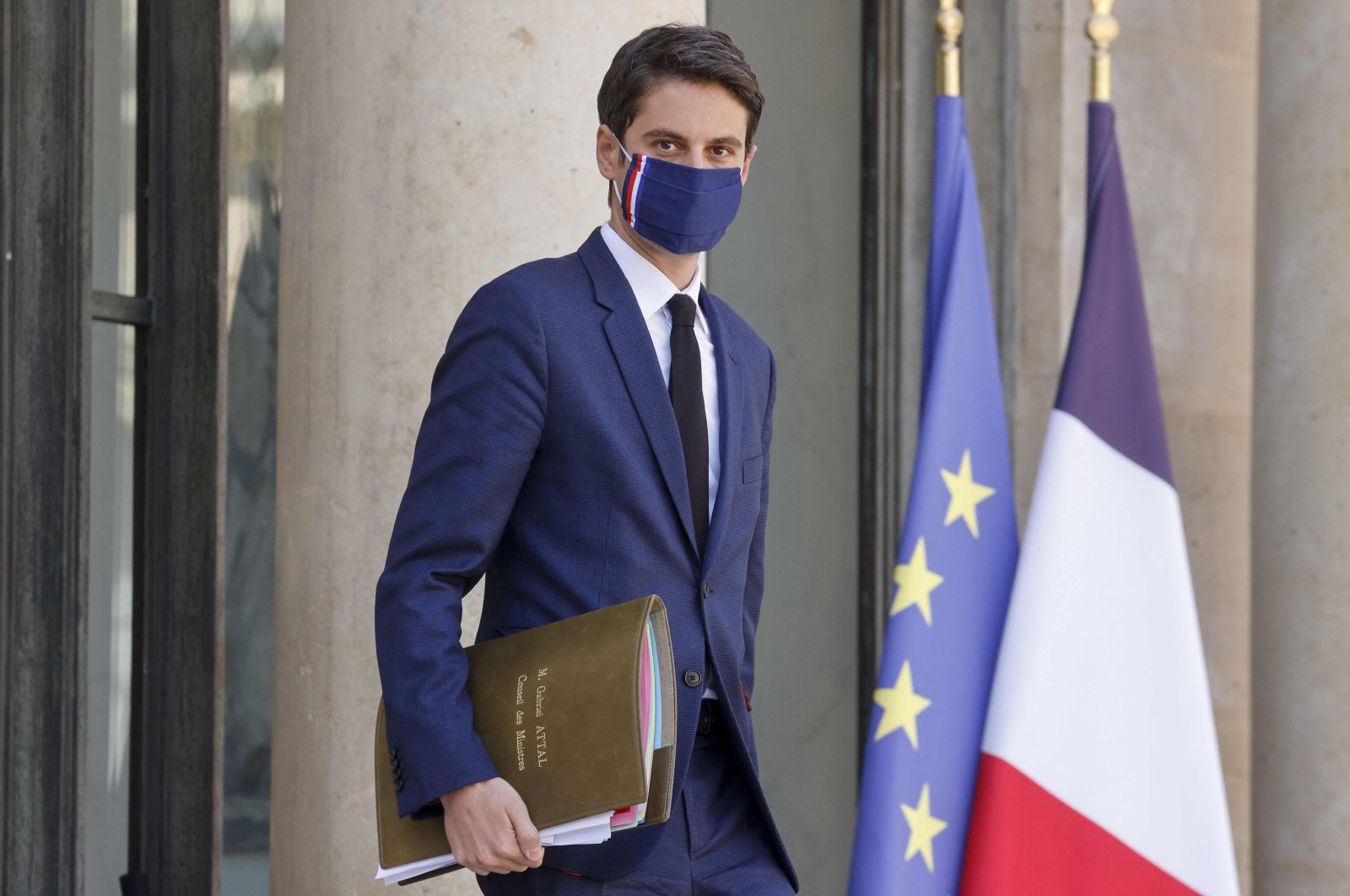 Gabriel Attal, France's secretary of state and government spokesperson, wearing a protective face mask, leaves after a weekly Cabinet meeting at the Elysee Presidential Palace in Paris, France, March 31, 2021. (Photo by Ludovic MARIN via AFP)