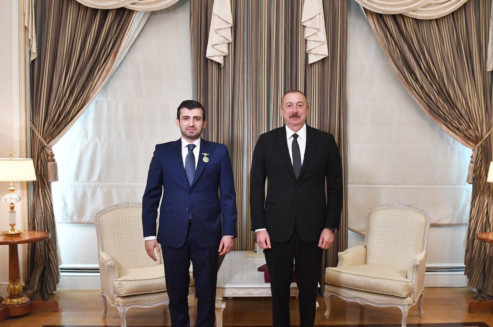 Baykar's CTO Selçuk Bayraktar (L), Azerbaijan's President Ilham Aliyev, Baku, Azerbaijan, April 1, 2021. (Photo by the Presidency of Azerbaijan via AA)
