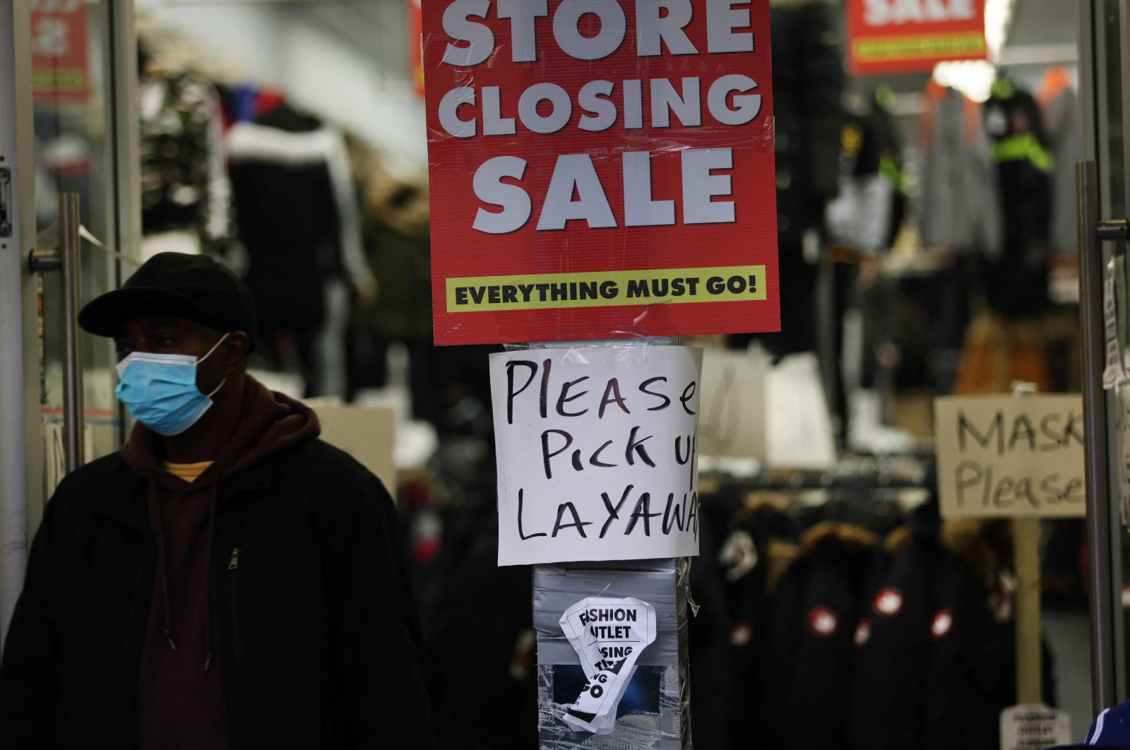 Sale signs are displayed in the window of a business in Brooklyn in New York City, U.S., Dec. 1, 2020. (AFP Photo)