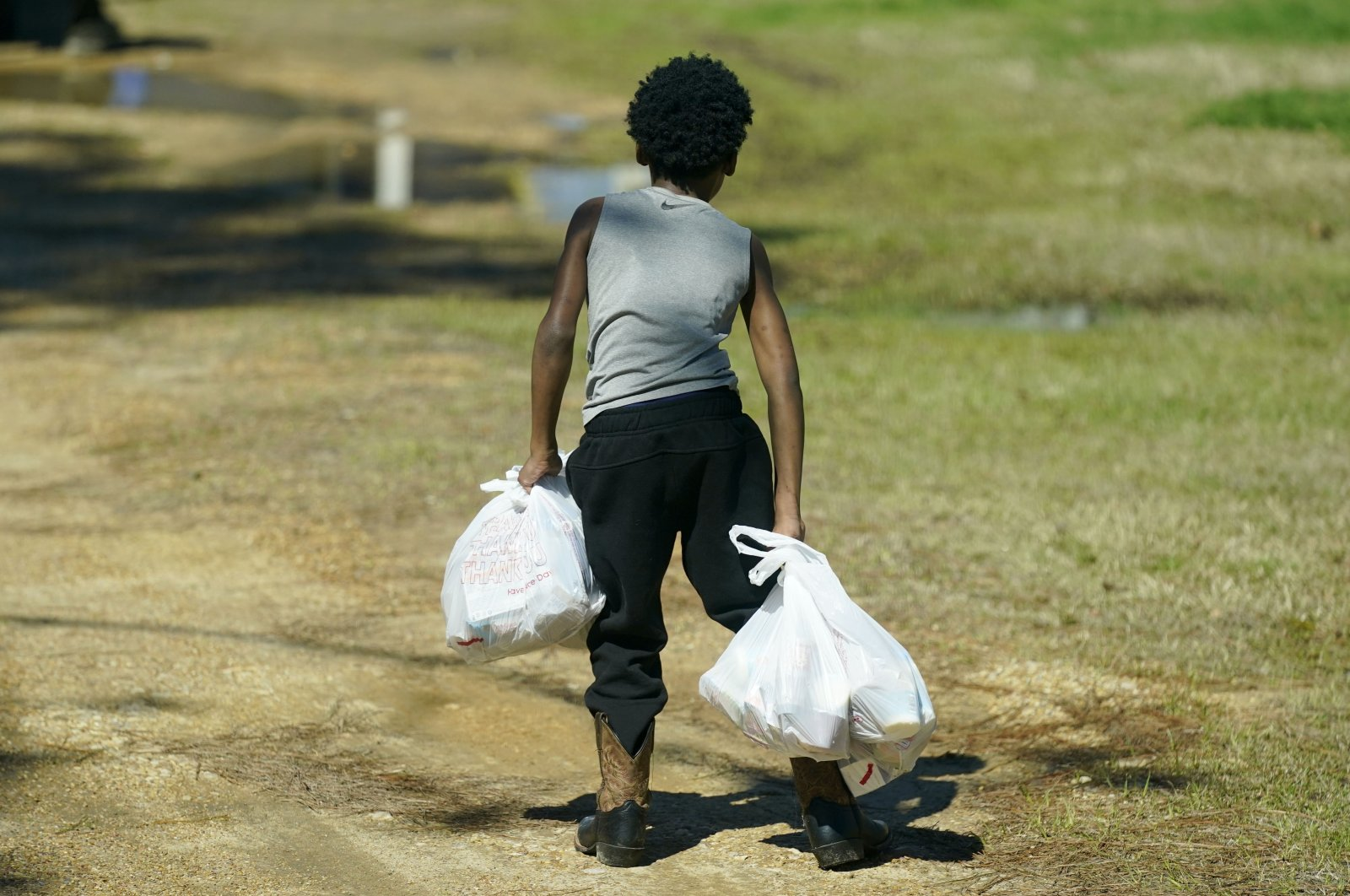 A Jefferson County student carries several days of breakfasts and lunches back to his home, in Fayette, Mississippi, U.S., March 3, 2021. (AP Photo)