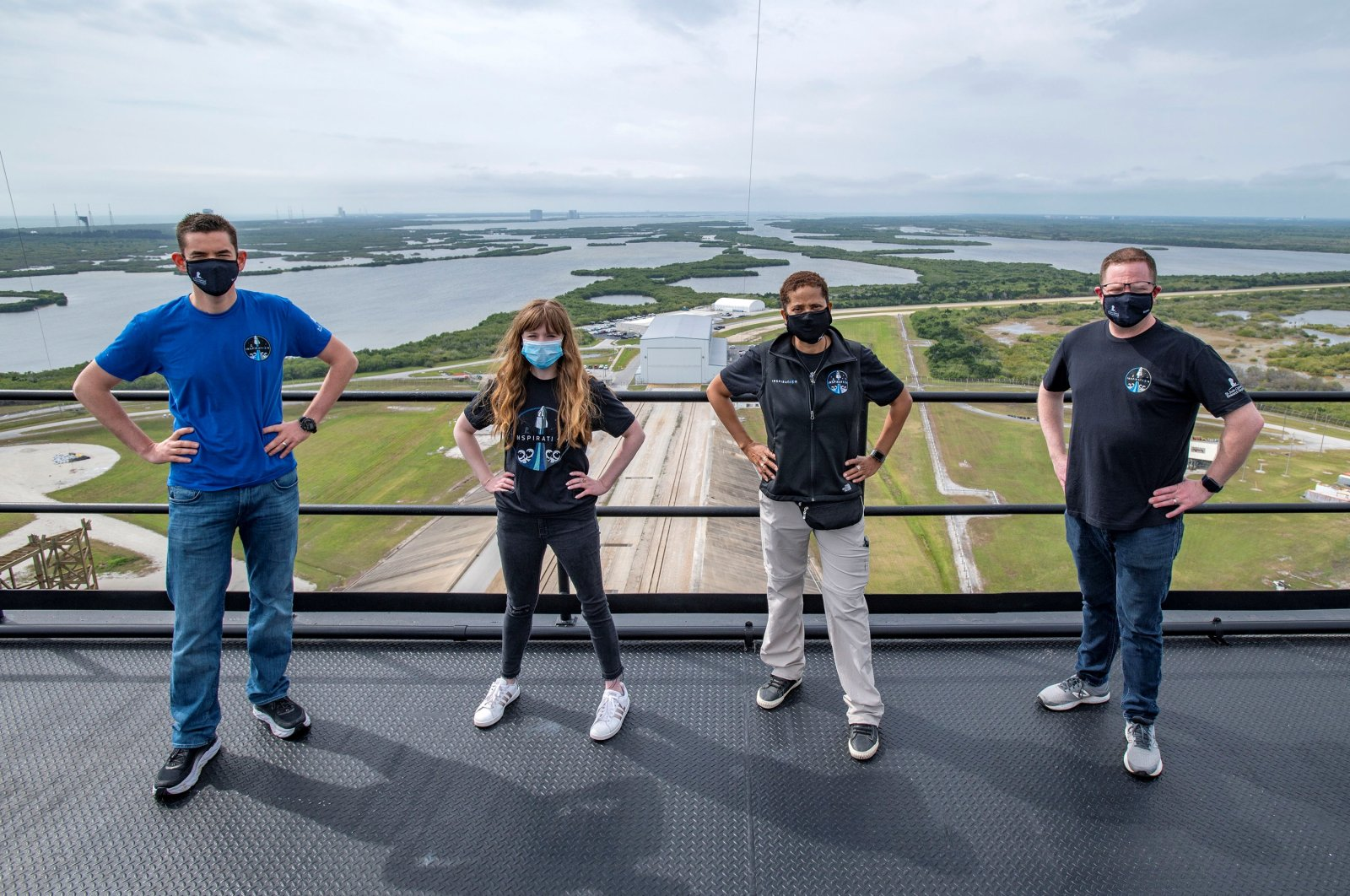 (L-R) Jared Isaacman, Hayley Arceneaux, Sian Proctor and Chris Sembroski pose for a photo at the SpaceX launch tower at NASA's Kennedy Space Center at Cape Canaveral, Florida, U.S., March 29, 2021. (SpaceX Handout via Reuters)