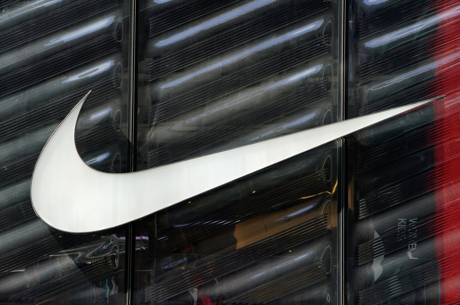 The Nike swoosh logo is seen outside the store on 5th Ave in New York, New York, U.S., March 19, 2019. (Reuters/Carlo Allegri/File Photo)