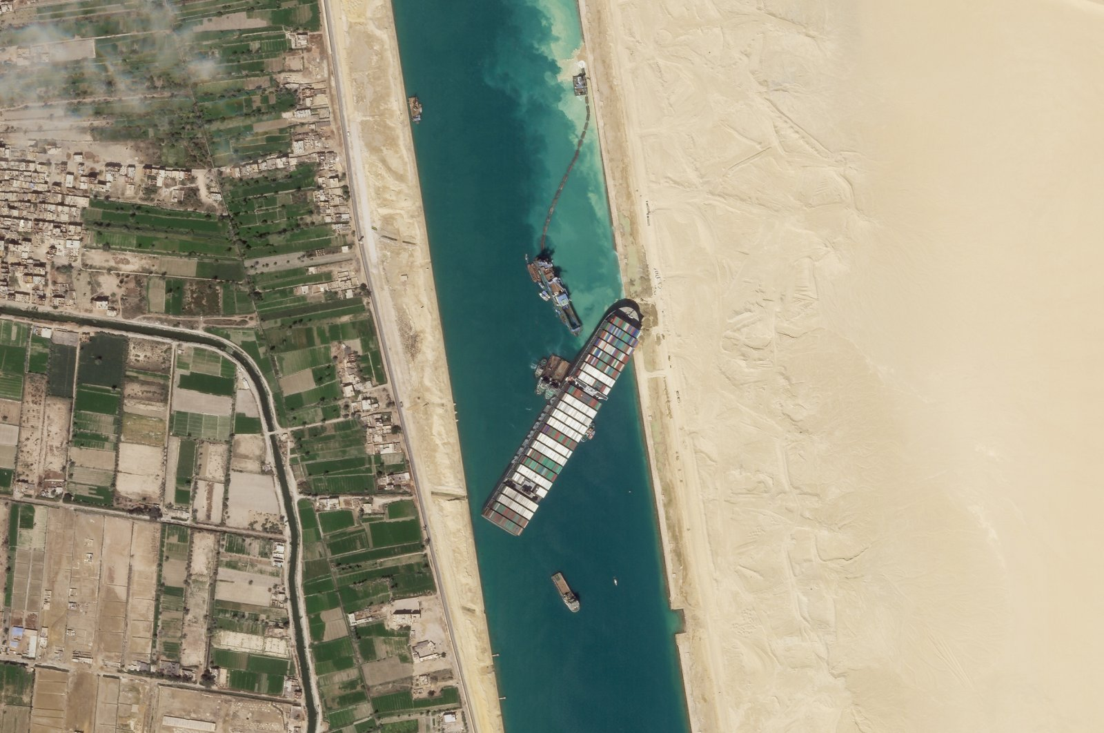 This satellite image from Planet Labs Inc. shows the cargo ship MV Ever Given stuck in the Suez Canal near Suez, Egypt, Sunday, March 28, 2021. (Planet Labs Inc. via AP)