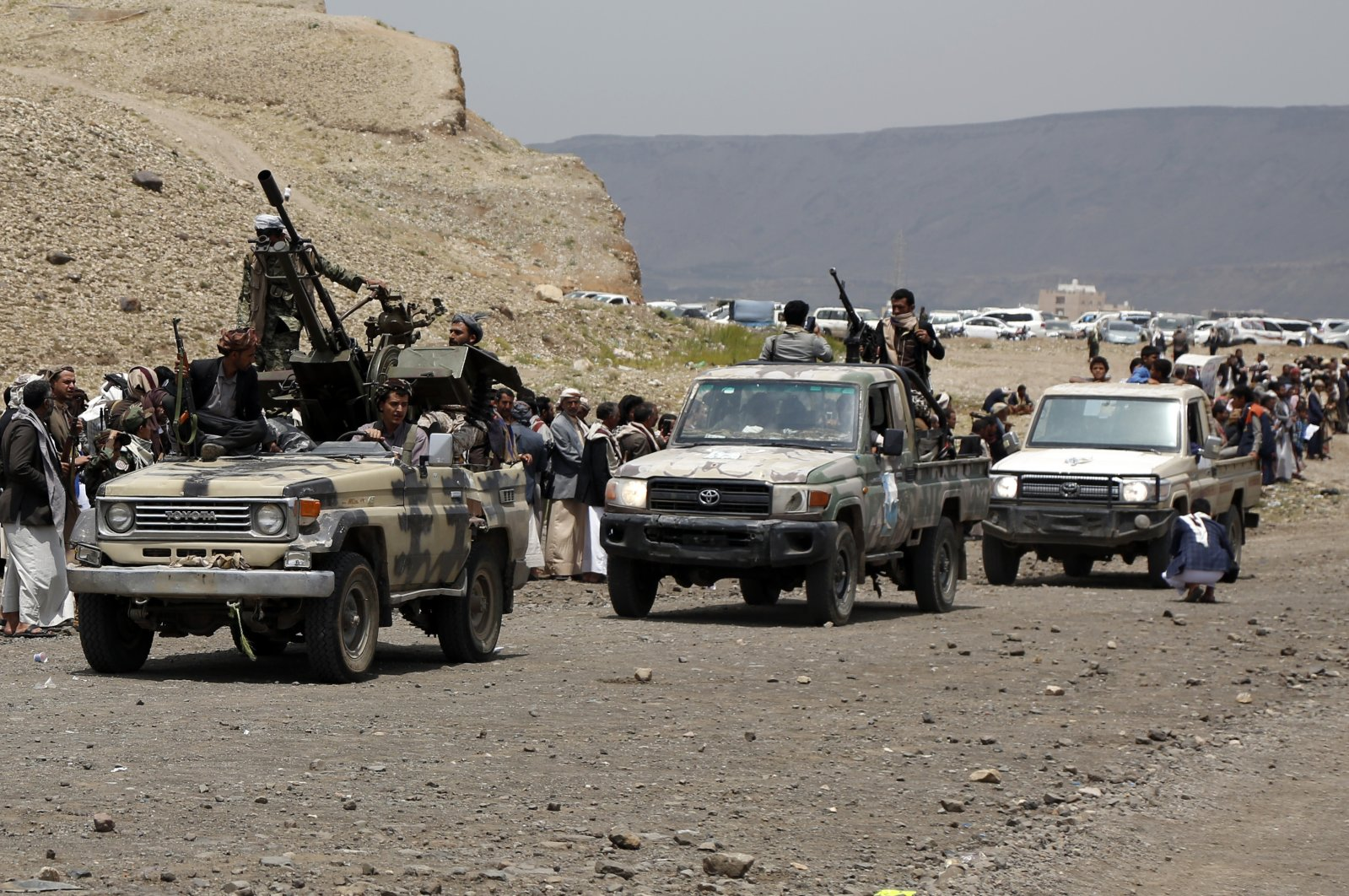 Tribespeople loyal to the Houthis ride trucks mounted with machine guns during an armed tribal gathering on the outskirts of Sanaa, Yemen, July 8, 2020. (Photo by Getty Images)