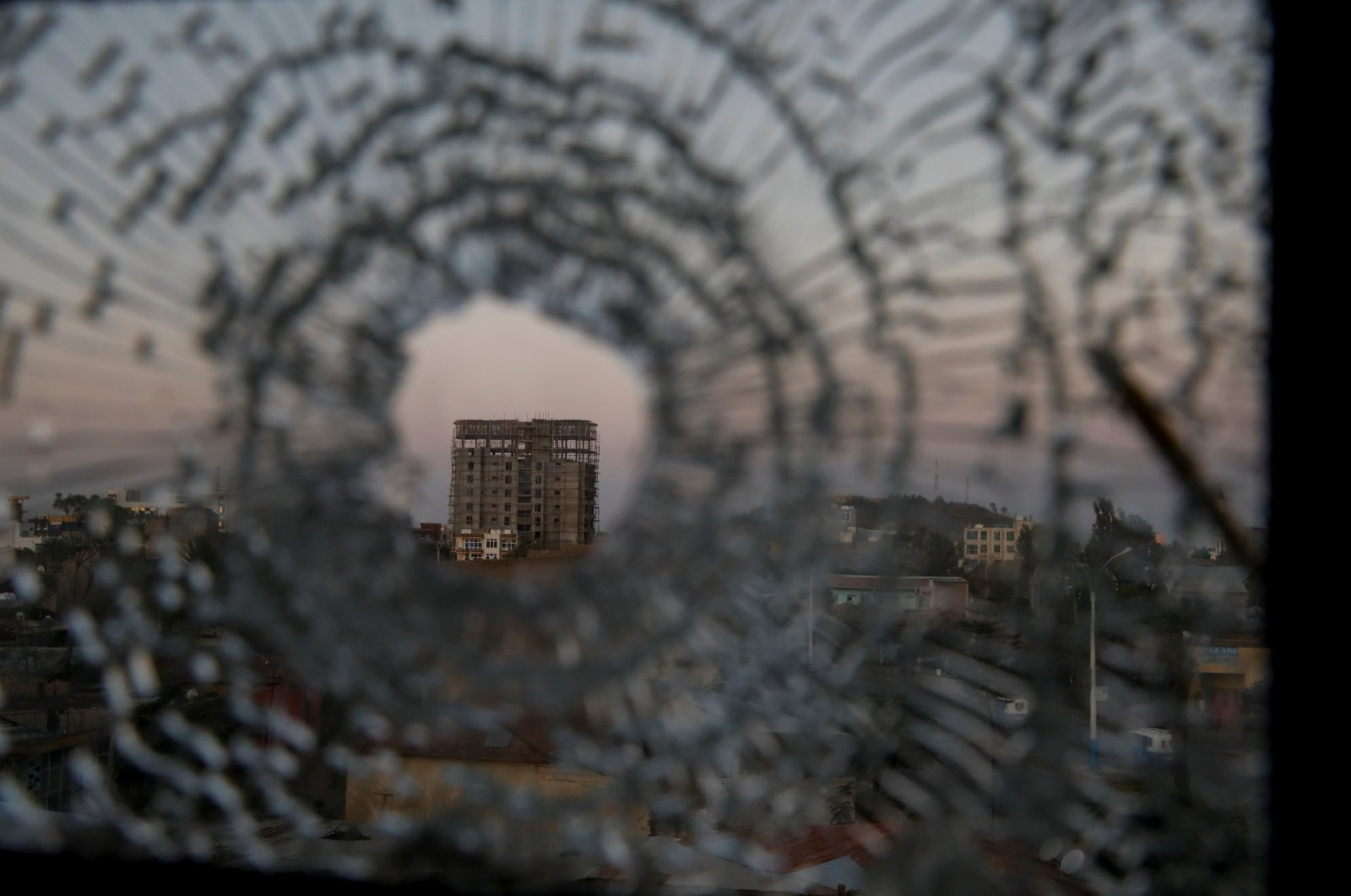 A building is seen through a bullet hole in a window of the Africa Hotel in the town of Shire, Tigray region, Ethiopia, March 17, 2021. (Reuters Photo)
