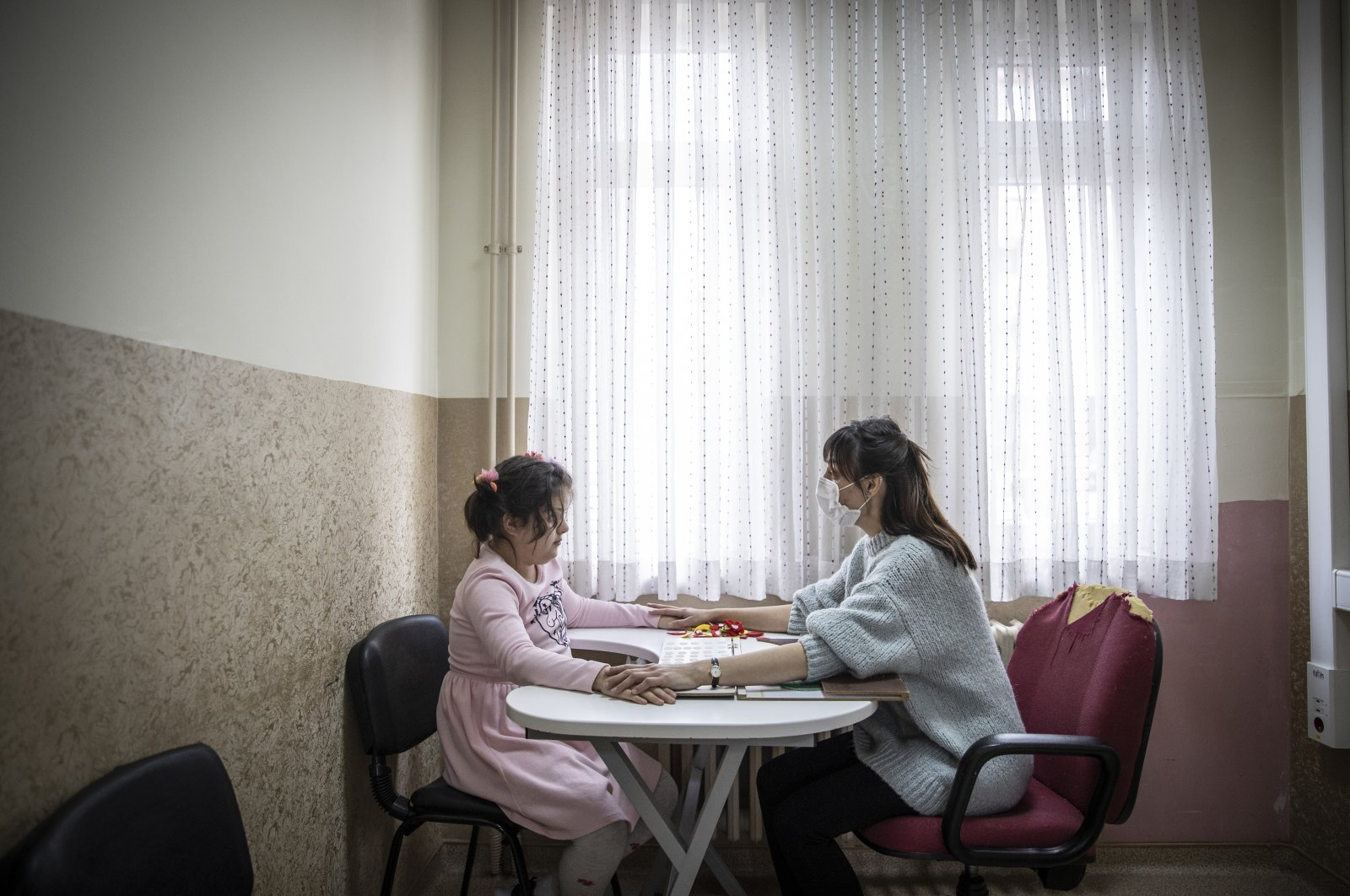 An autistic student (L) attends a session with her teacher at a special education class in a school, in the capital Ankara, Turkey, April 2, 2021. (AA PHOTO)