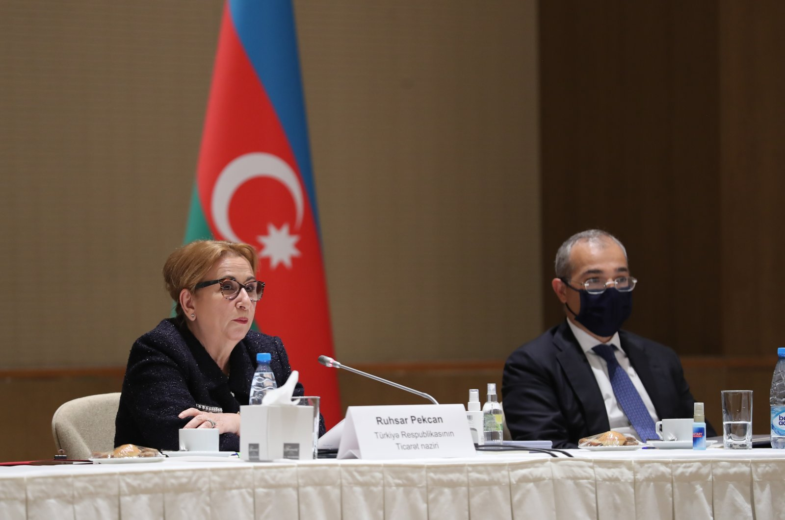Turkey's Trade Minister Ruhsar Pekcan (L) and Azerbaijan's Economy Minister Mikayıl Cabbarov during a roundtable meeting with nongovernmental organizations (NGO) in Baku, Azerbaijan, April 2, 2021. (AA Photo)