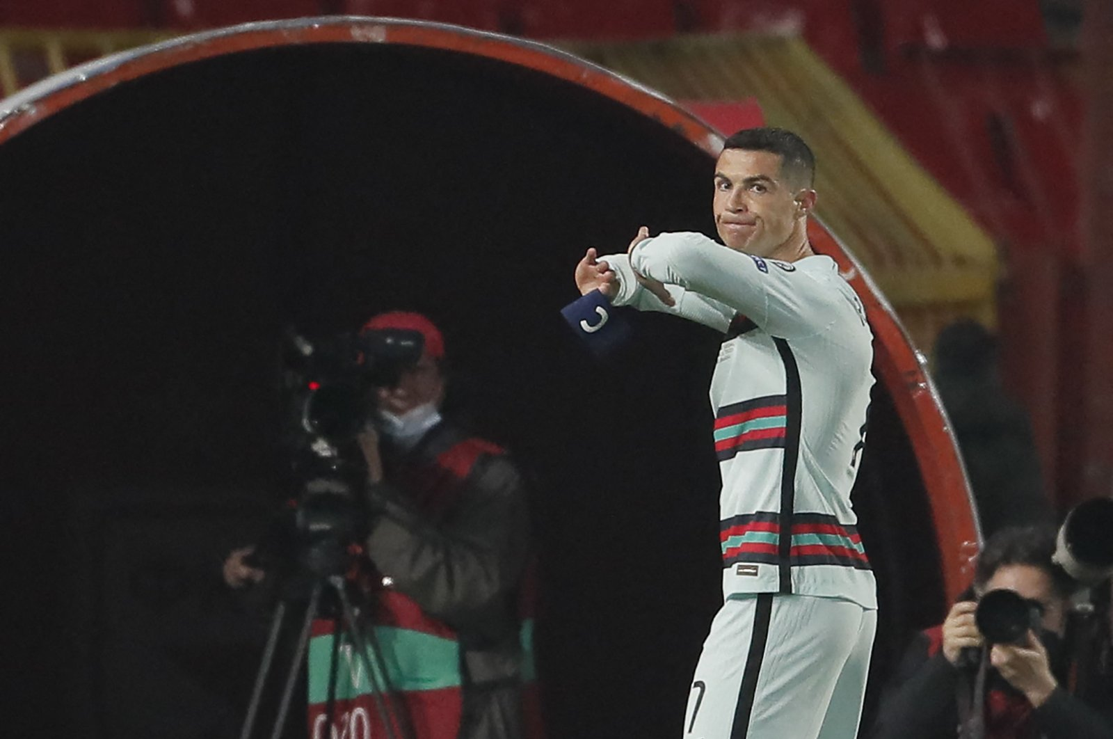 Portugal forward Cristiano Ronaldo holds his captain armband moments before he threw it to the ground and left the pitch at the end of the FIFA World Cup Qatar 2022 qualification Group A match against Serbia at the Rajko Mitic Stadium, in Belgrade, Serbia, March 27, 2021.