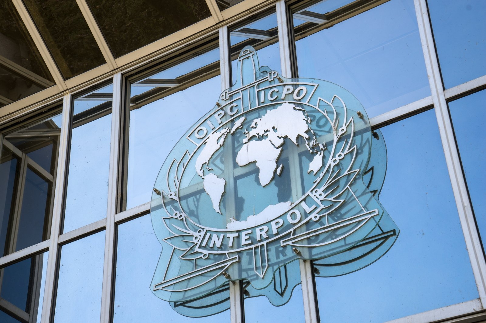 A sign on the facade of the Interpol headquarters. Interpol is an intergovernmental organization facilitating international police cooperation, Lyon, France, Sep. 21, 2015. (Shutterstock.com)