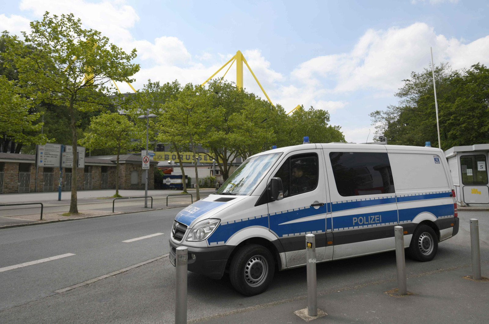 A police car stands at the Signal Iduna Park before the German first division Bundesliga football match in Dortmund, May 16, 2020. (AFP File Photo)