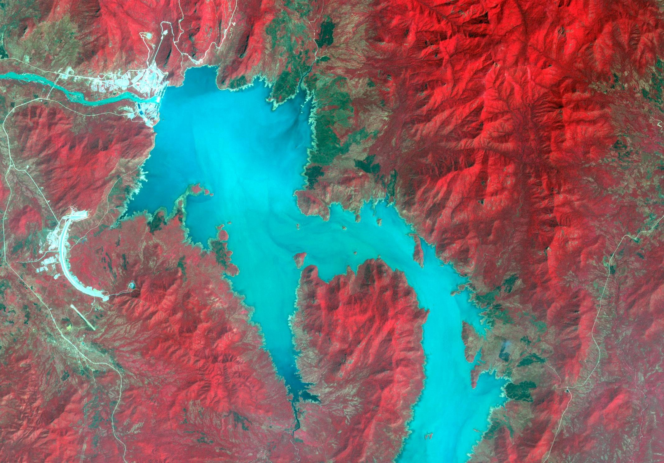 The Blue Nile River is seen as the Grand Ethiopian Renaissance Dam reservoir fills near the Ethiopia-Sudan border, in this broad spectral image taken November 6, 2020. (NASA/METI/AIST/Japan Space Systems, and U.S./Japan ASTER Science Team/Handout via Reuters)