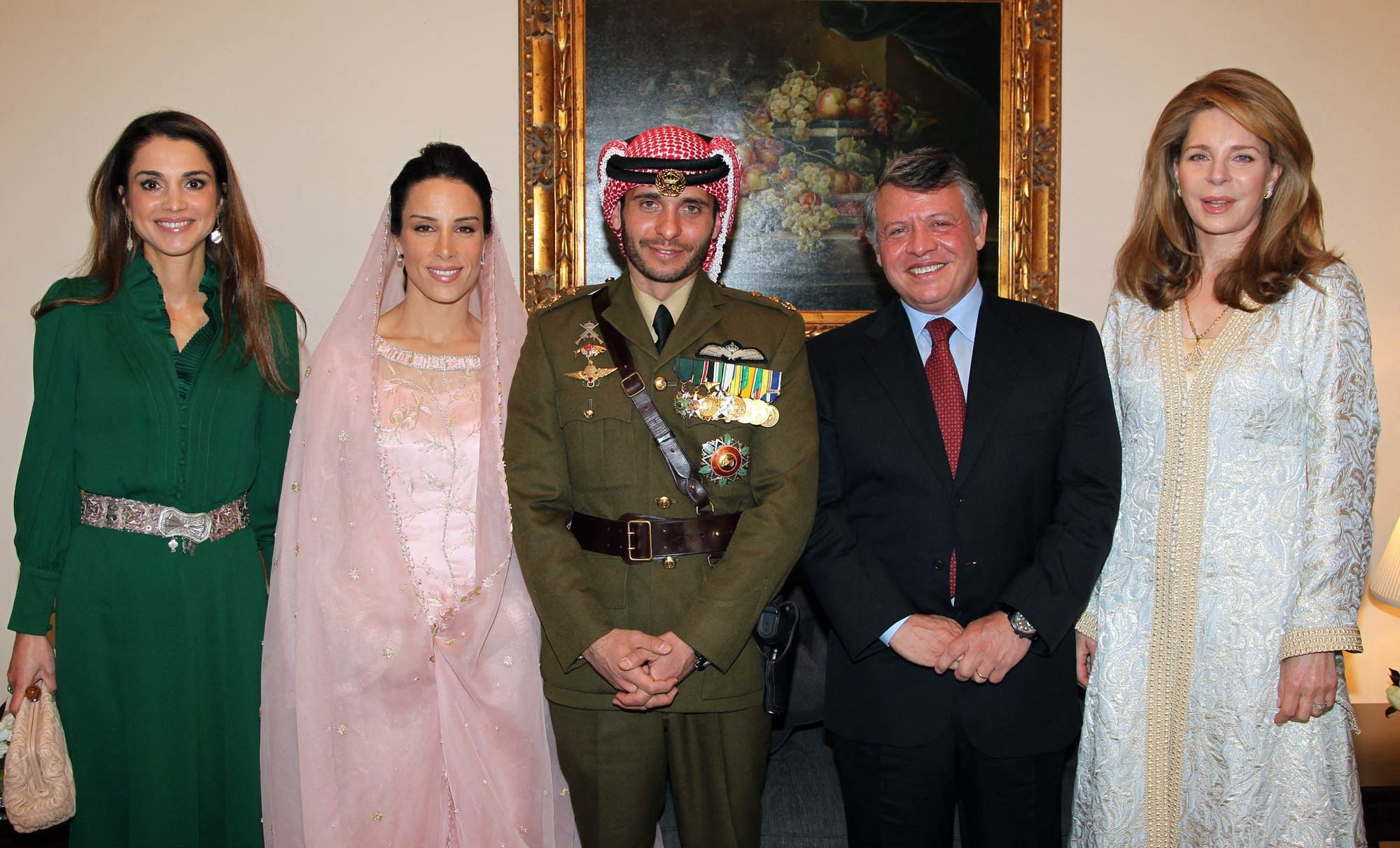 In this file handout picture released by the Jordanian news agency Petra on January 12, 2012, shows Jordan's King Abdullah (2nd R), Queen Noor, widow of late King Hussein (R), and Queen Rania (L) posing for a picture with Prince Hamza, half-brother of Jordan's King Abdullah and his new wife Princess Basma Otoum during their Muslim wedding ceremony at the Royal Palace in Amman. (Photo by Yousef Allan/Petra via AFP)