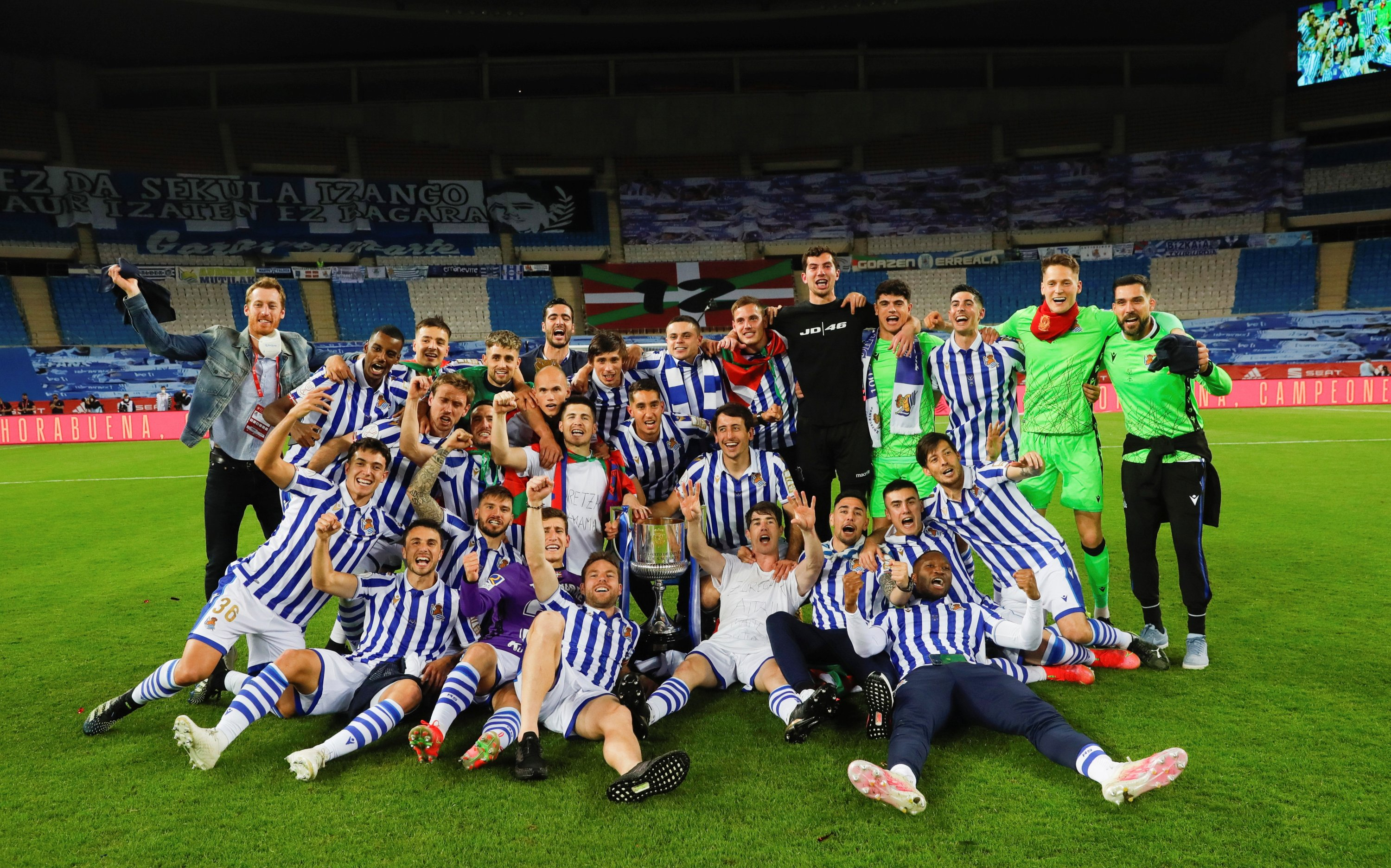 A handout photo made available by the Spanish Royal Soccer Federation (RFEF) shows Real Sociedad players after winning the 2020 Copa Del Rey final match against Athletic Bilbao at La Cartuja stadium in Seville, Andalusia, Spain, April 03, 2921. (RFEF via EPA)