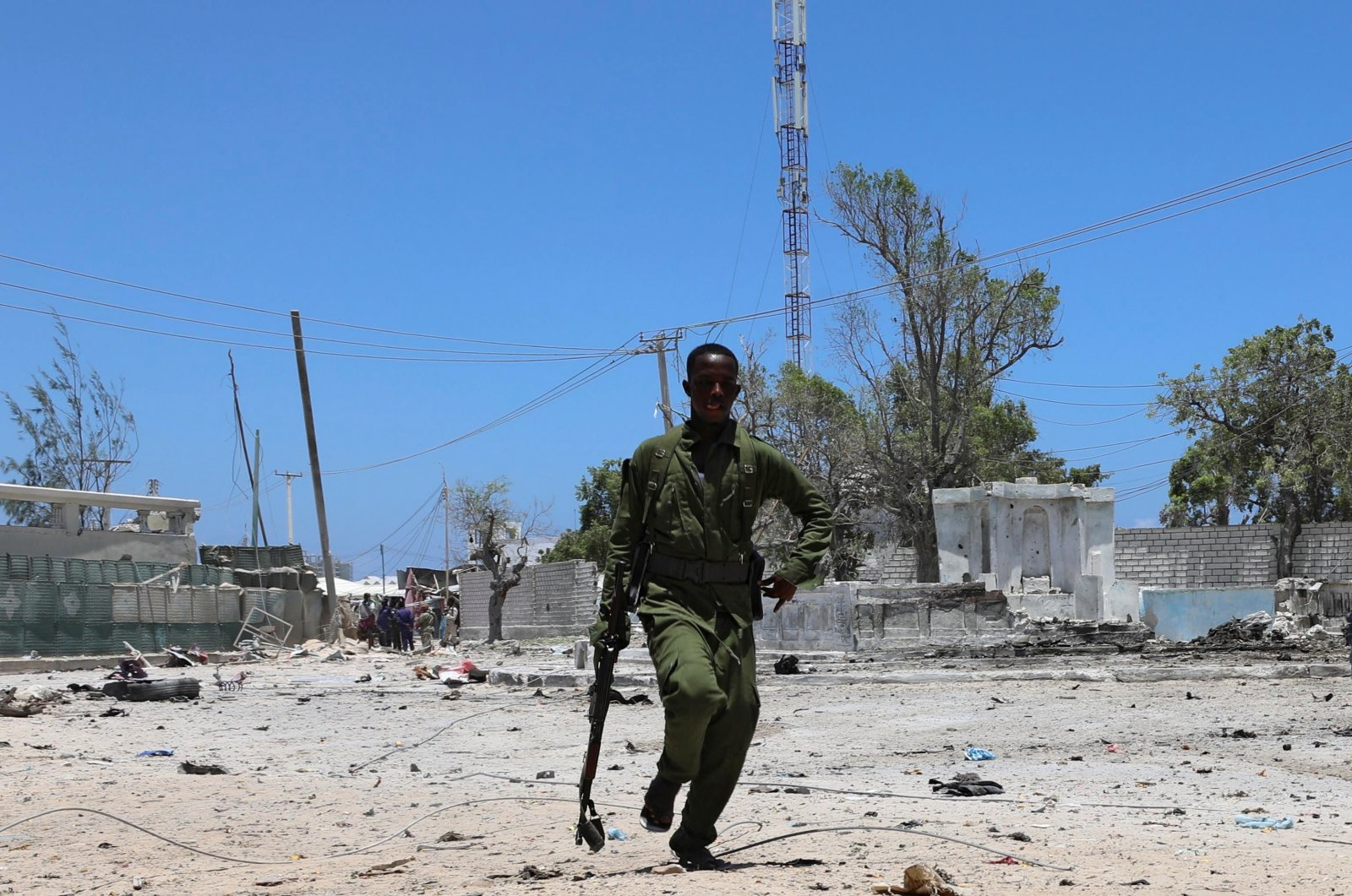 A Somali soldier runs to hold a position as al-Shabab militia storm a government building in Mogadishu, Somalia, March 23, 2019. (Reuters Photo)