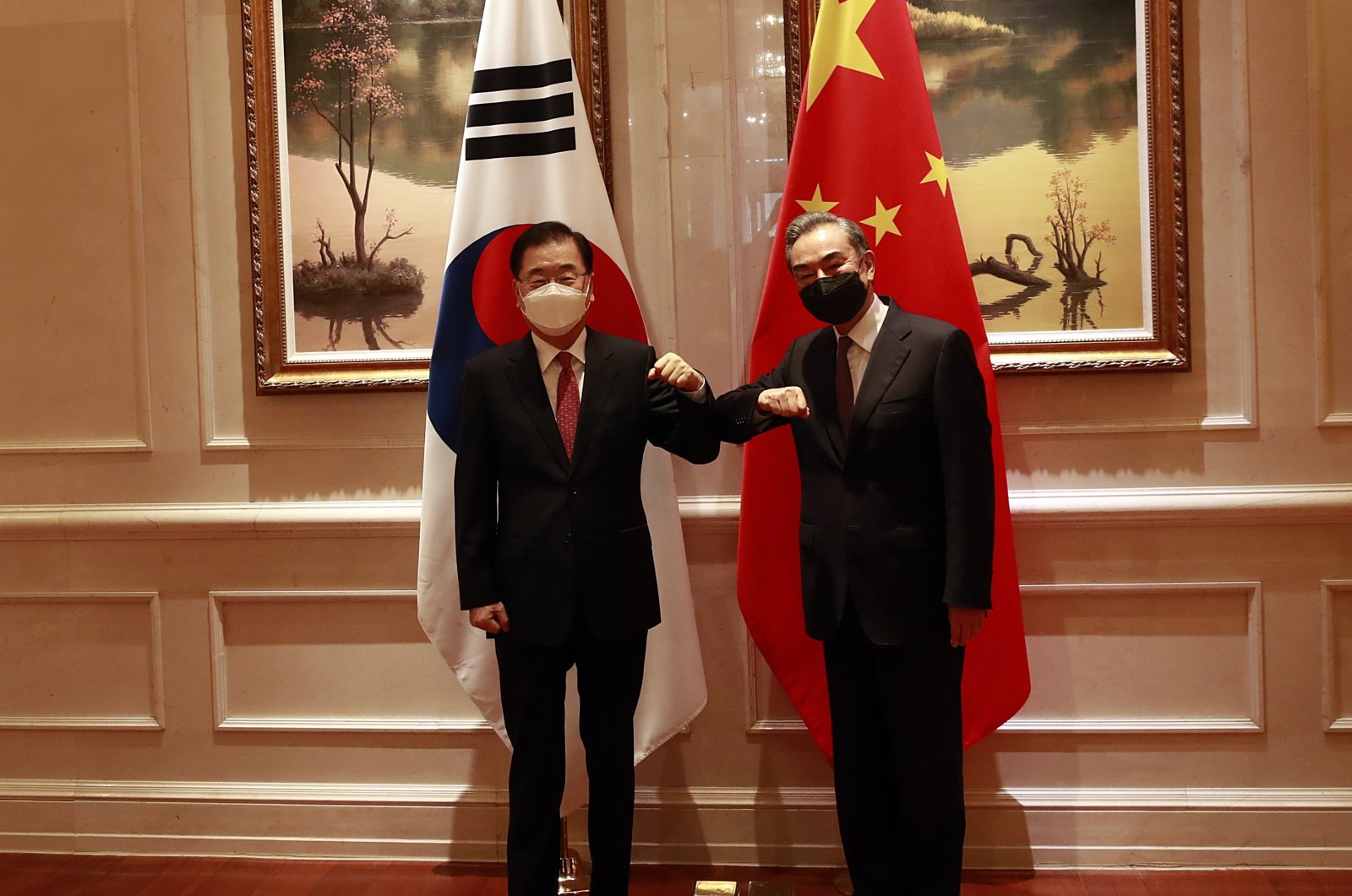 South Korean Foreign Minister Chung Eui-yong (L) and his Chinese counterpart Wang Yi (R) bump elbows as they pose for photographs ahead of their talks in Xiamen, China, April 03, 2021. (EPA Photo)