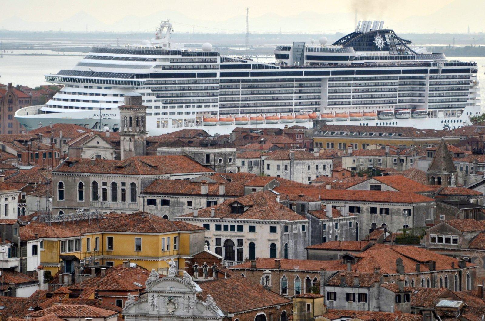 """The cruise ship """"MSC Preziosa"""" navigating in the Canale della Giudecca, Venice, Italy, April 5, 2014 (reissued 26 March 2021). (EPA Photo)"""