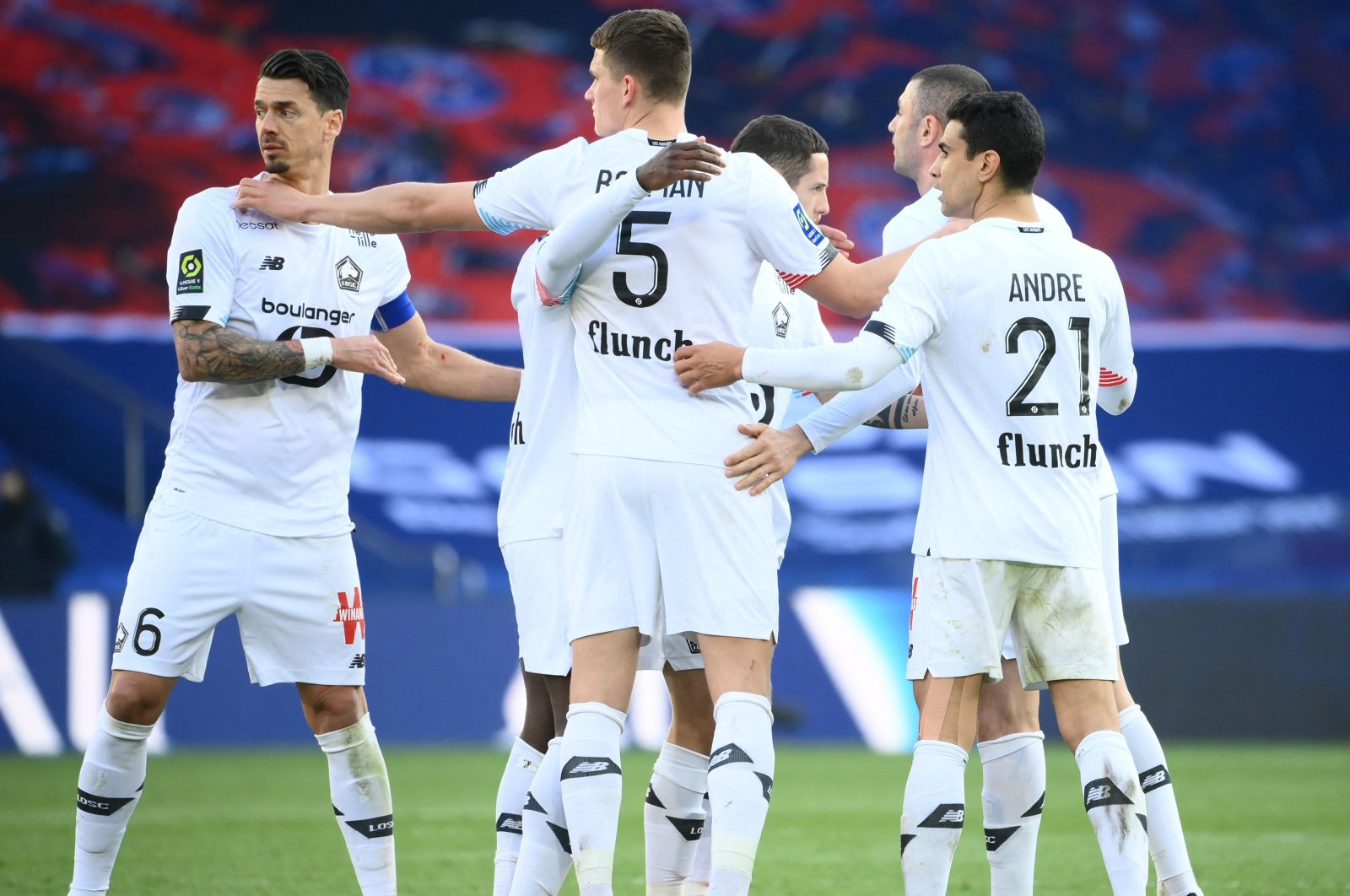 Lille's players celebrate after winning the French Ligue 1 football match between Paris-Saint Germain and Lille (LOSC) at the Parc des Princes Stadium in Paris, on April 3, 2021. (AFP Photo)