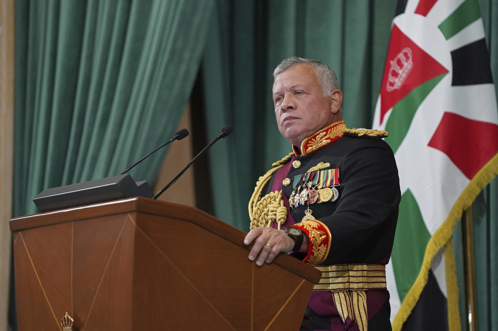 In this photo released by the Royal Hashemite Court, Jordan's King Abdullah II gives a speech during the inauguration of the 19th Parliament's non-ordinary session, Amman, Jordan, Thursday, Dec. 10, 2020. (Yousef Allan/The Royal Hashemite Court via AP)