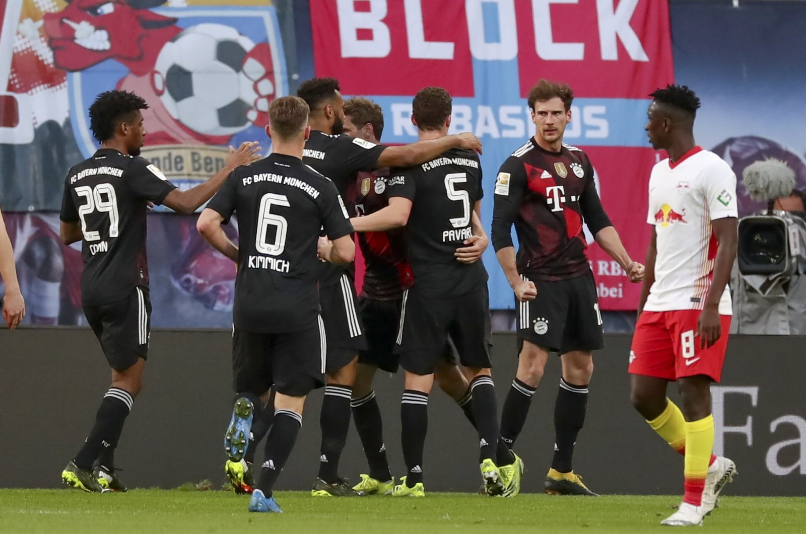 Bayern Munich's Leon Goretzka (2nd R) celebrates with teammates after scoring the opening goal during the German Bundesliga soccer match against RB Leipzig at Red Bull Arena, Leipzig, Germany, April 03, 2021. (Filip Singer/Pool/DFL via EPA)