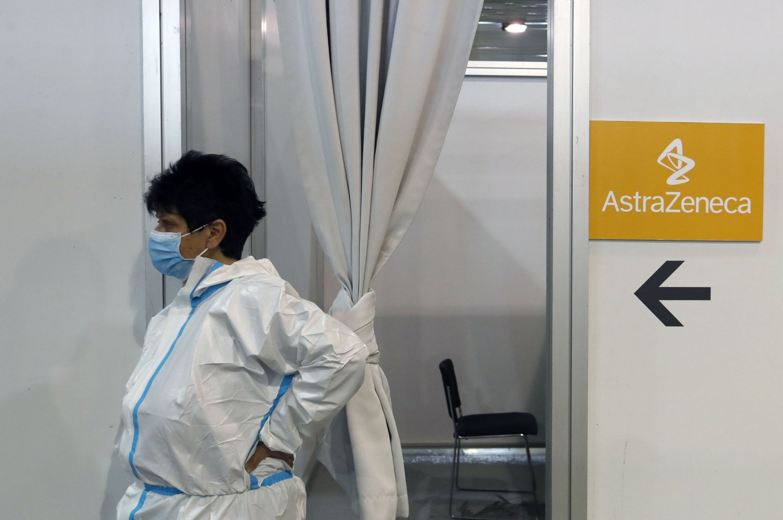 A medical worker wearing protective gear waits for people to receive the COVID-19 vaccine at a vaccination center in Belgrade, Serbia, March 23, 2021. (AP Photo)