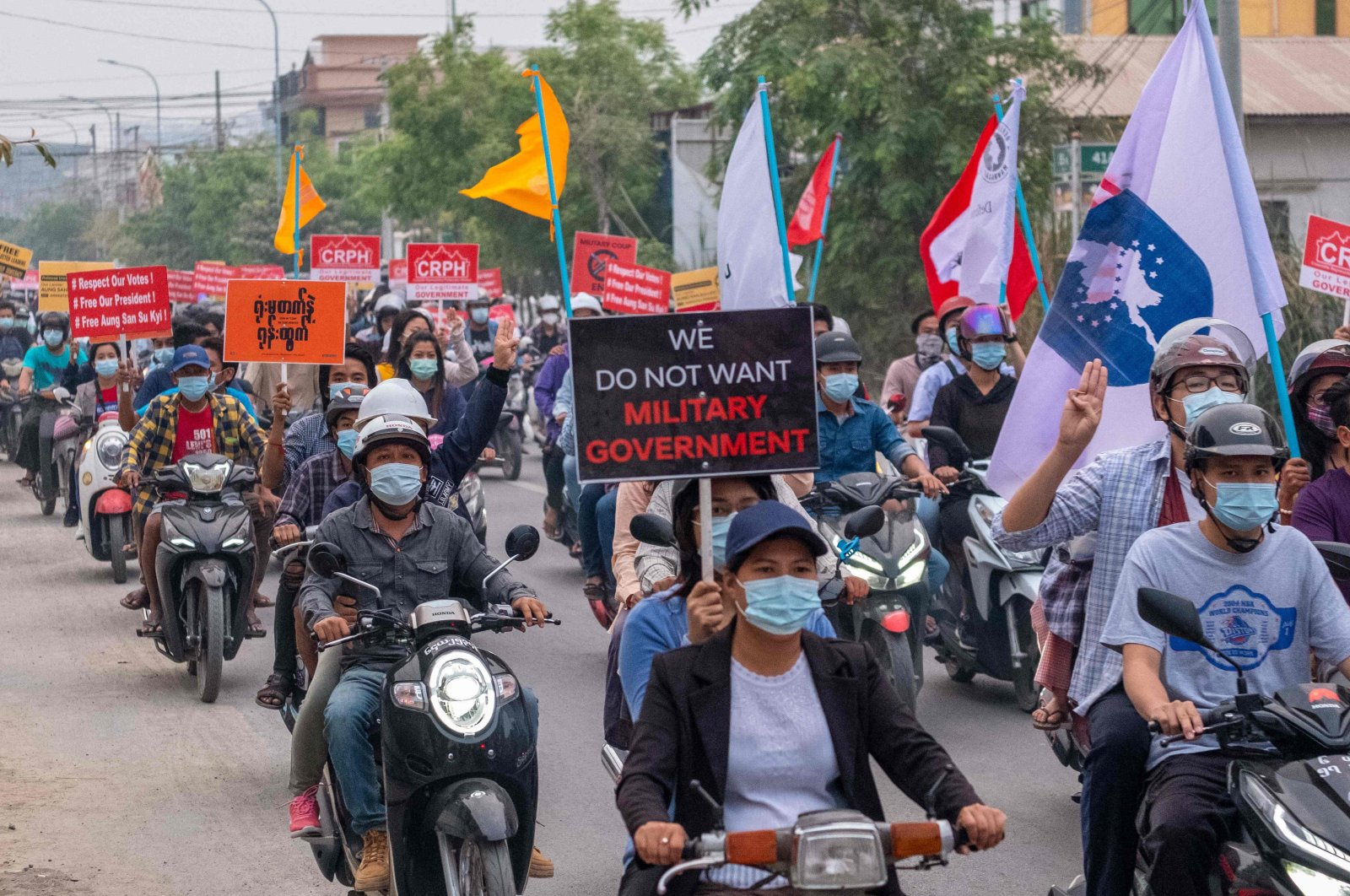 This photo taken and received from an anonymous source via Facebook shows protesters taking part in a demonstration against the military coup in Mandalay, Myanmar, April 4, 2021. (AFP Photo)