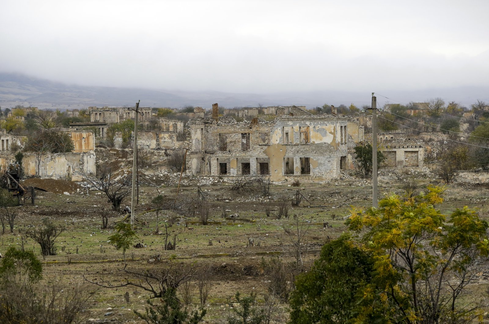 A view of a vast expanse of jagged concrete and houses are seen in Aghdam, once a lively town of around 50,000 inhabitants, Azerbaijan, Nov. 19, 2020. (AP Photo)