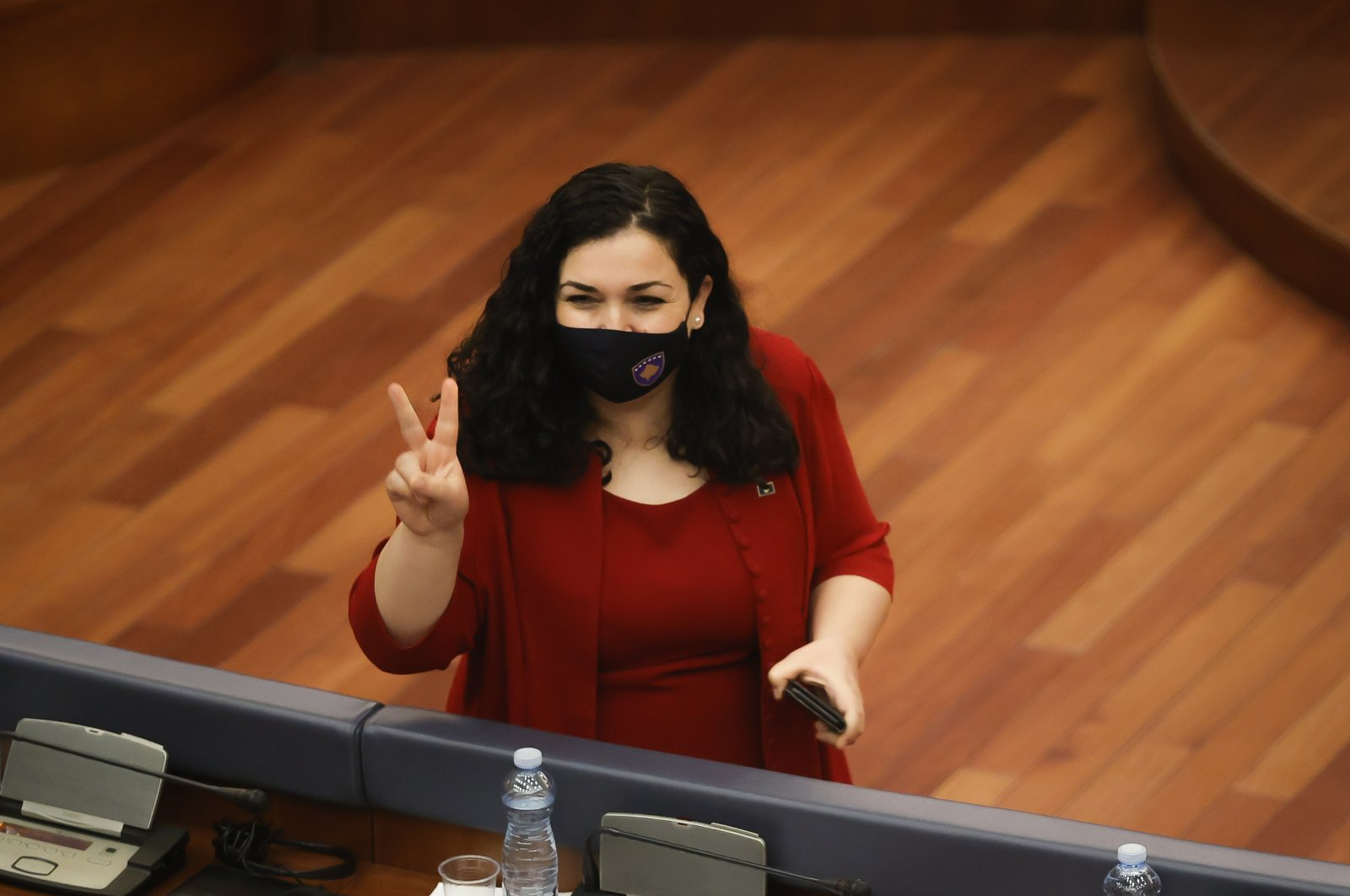 Vjosa Osmani candidate for the President of the Republic of Kosovo flashes victory sign during a parliament session to elect the new president in Pristina, Kosovo, April 3, 2021. (EPA Photo)