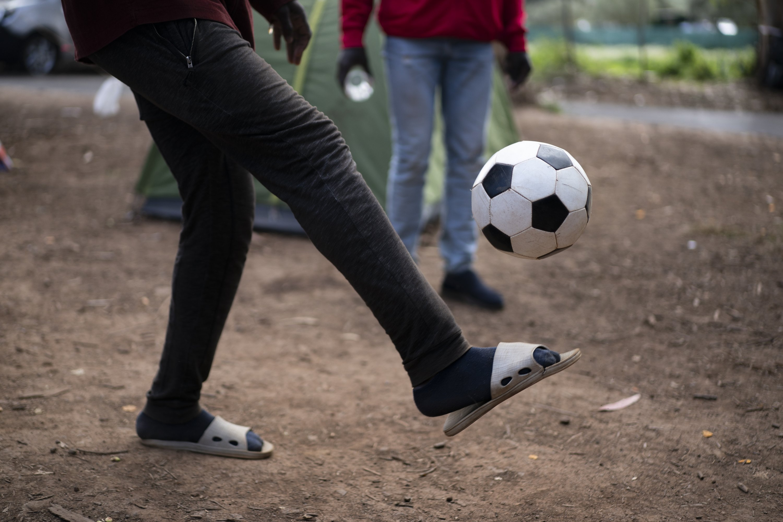 People play football at Las Raices camp in San Cristobal de la Laguna, in the Canary Island of Tenerife, Spain, March 20, 2021. (AP Photo)
