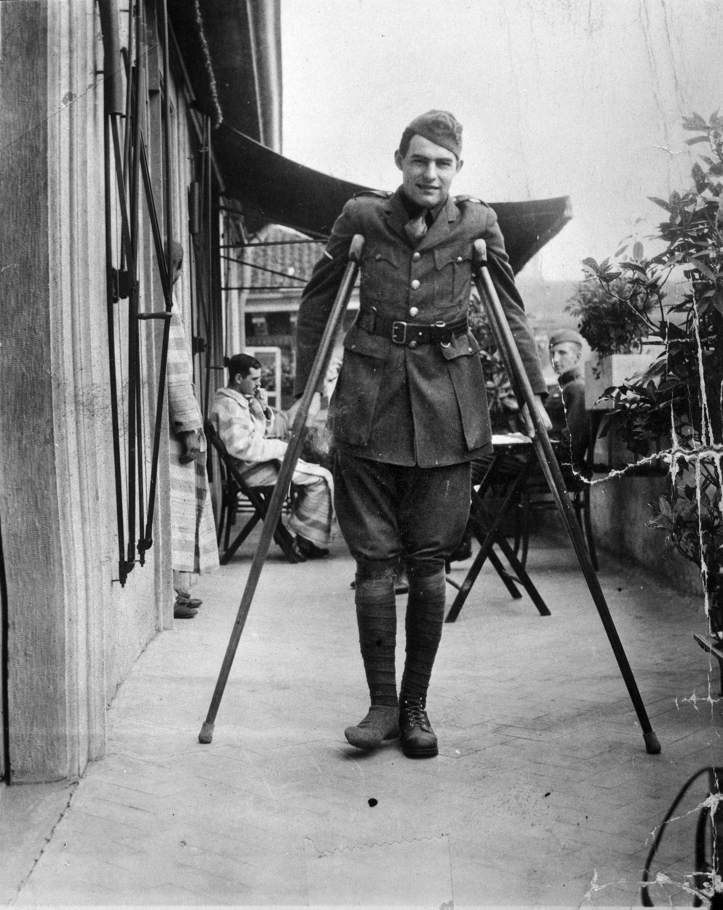 This 1918 photo provided by the John F. Kennedy Library Foundation shows Ernest Hemingway on crutches in Milan, Italy, where he was convalescing after being wounded while serving as an ambulance driver during World War I. (AP Photo)