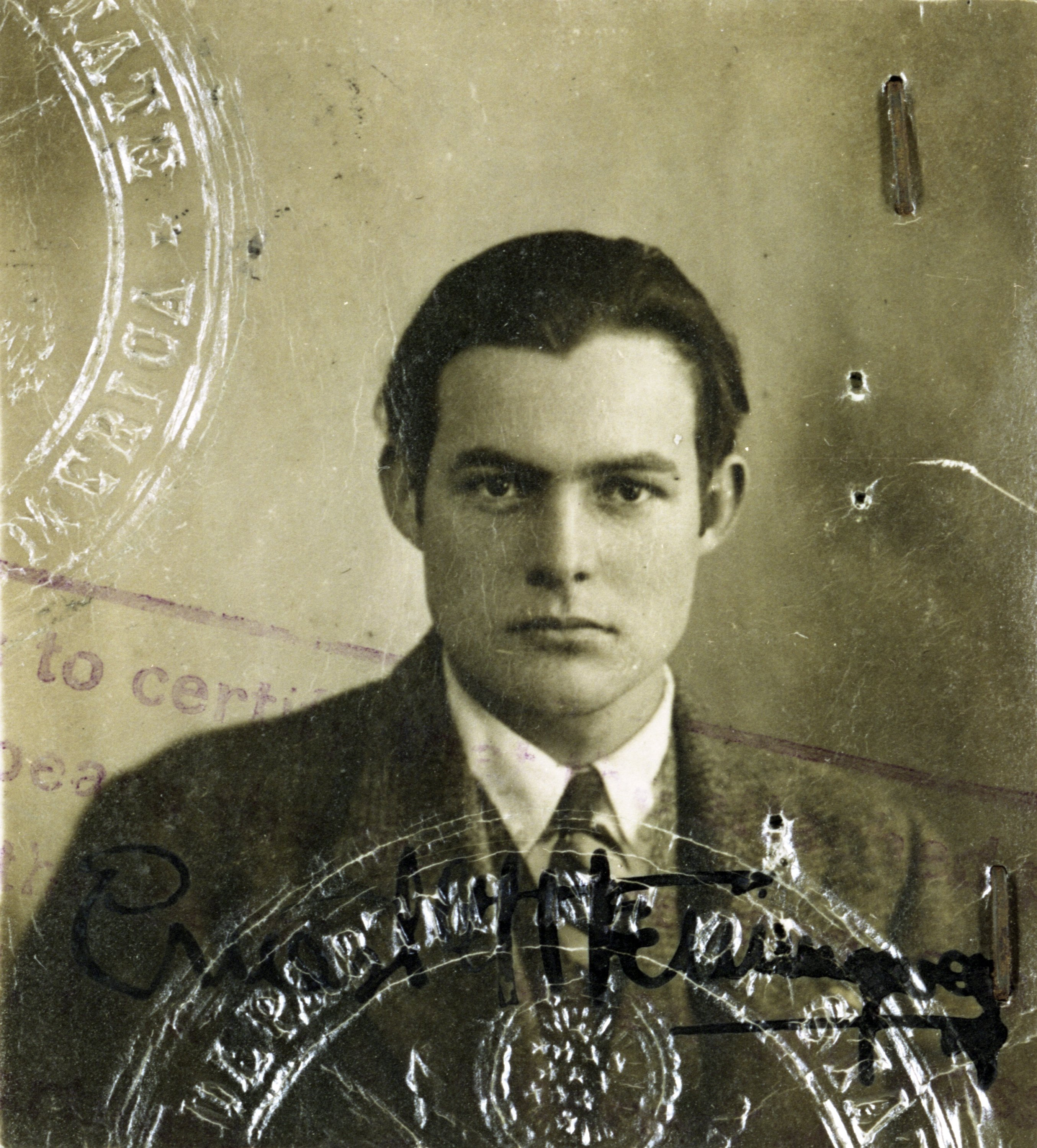 This 1920s photo provided by the John F. Kennedy Library Foundation shows Ernest Hemingway in his U.S. passport photo. (AP Photo)
