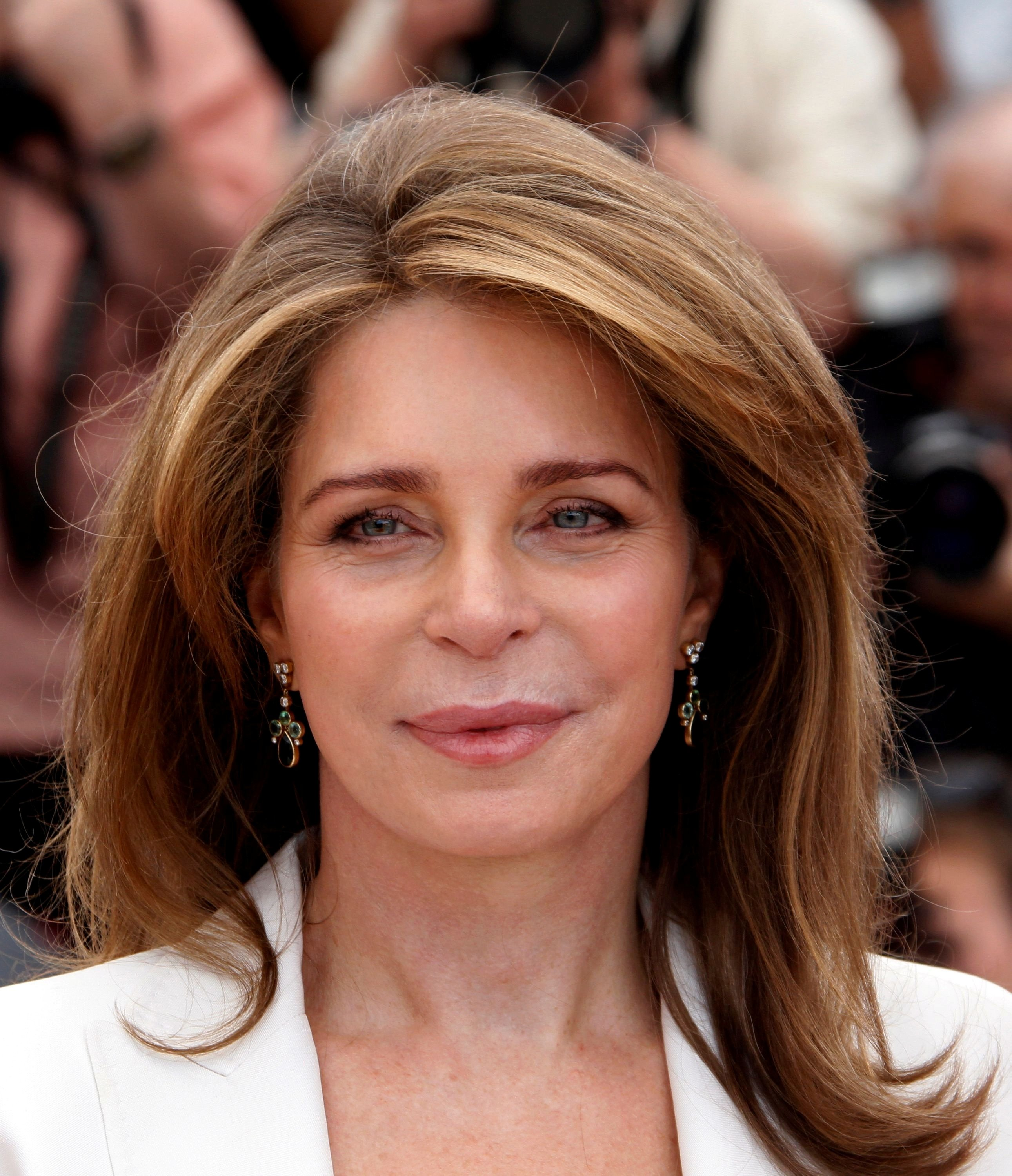 Queen Noor Al Hussein of Jordan poses during a photocall for the film 'Countdown to Zero' at the 63rd Cannes Film Festival, Cannes, France, May 16, 2010.   (REUTERS/Jean-Paul Pelissier/File Photo)