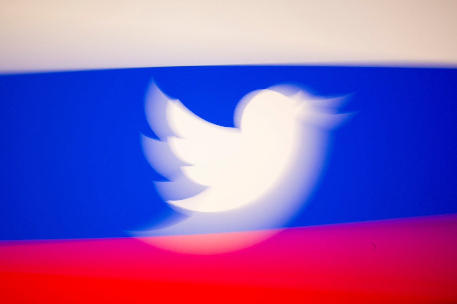Twitter logo and a Russian flag are displayed in this illustration picture taken March 10, 2021. (Reuters Photo)