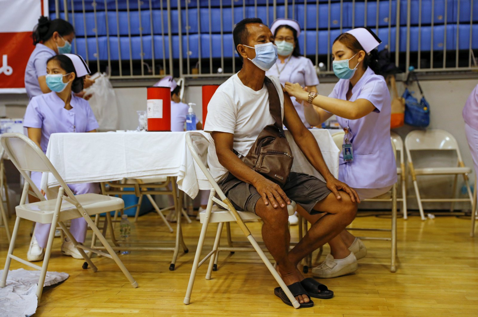 A man receives the Sinovac COVID-19 vaccine as the Thai resort island of Phuket rushes to vaccinate its population amid the coronavirus outbreak, and ahead of a July 1 ending of strict quarantine for overseas visitors, to bring back tourism revenue in Phuket, Thailand, April 1, 2021. (Reuters Photo)