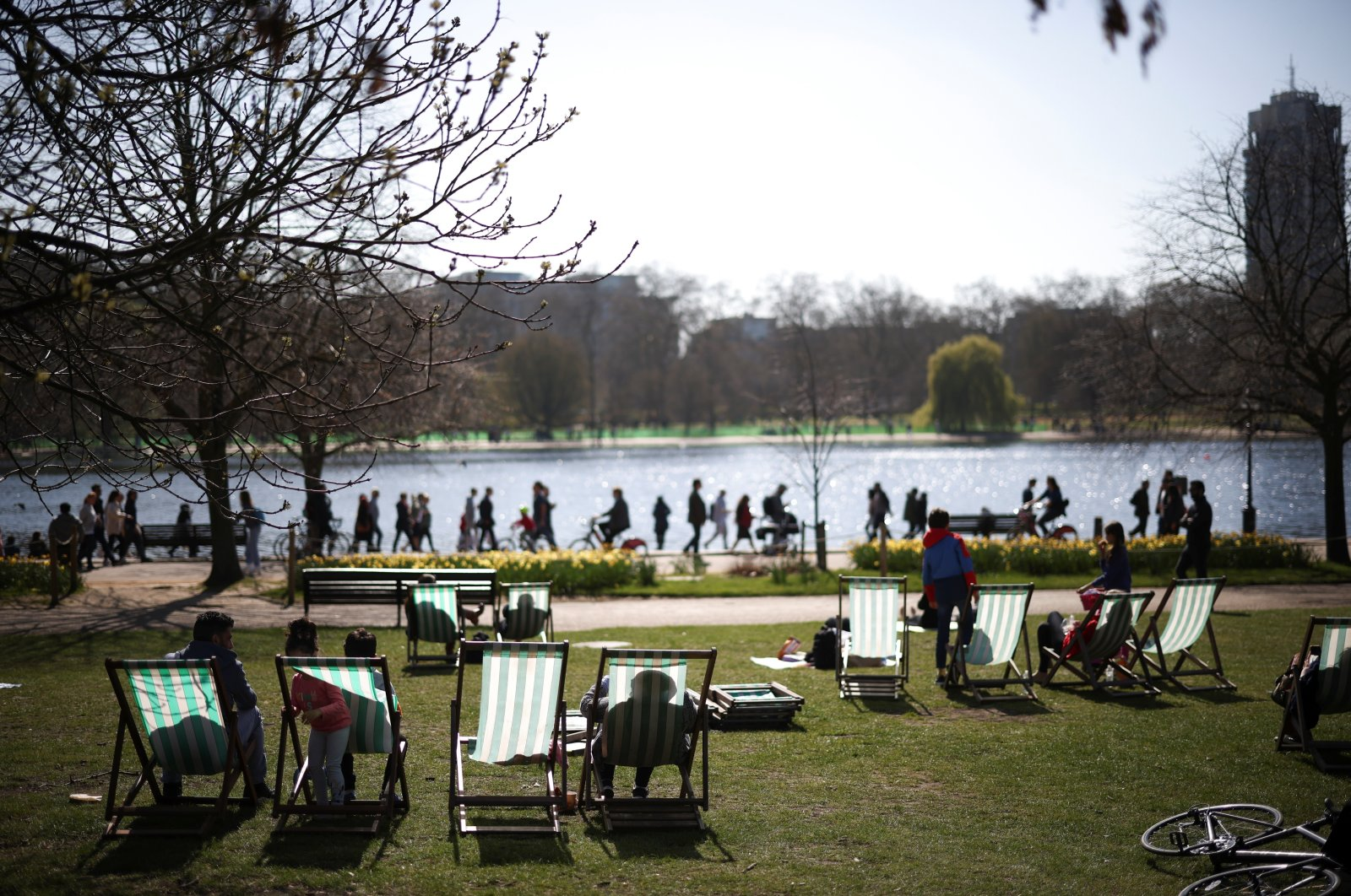 People relax during sunny weather in Hyde Park, amid the COVID-19 outbreak, London, Britain, April 4, 2021. (Reuters Photo)