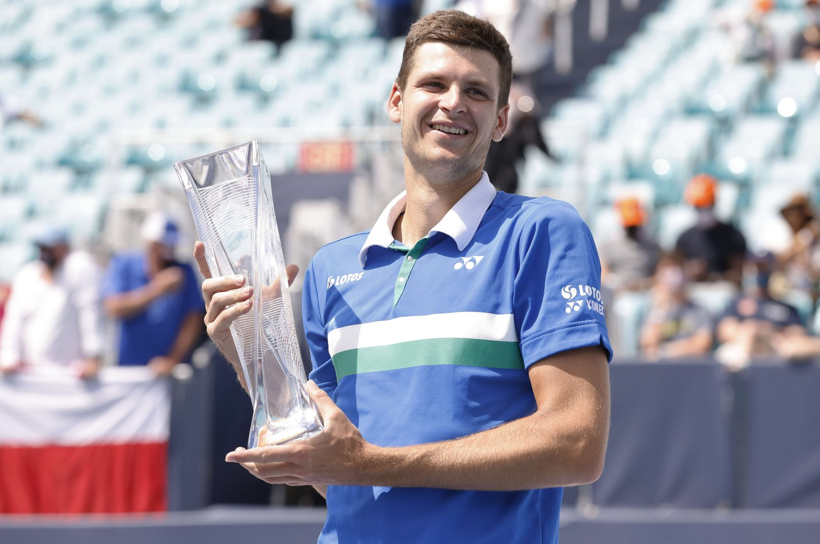 Poland's Hubert Hurkacz poses with the Miami Open trophy after beating Italy's Jannik Sinner in the final at Hard Rock Stadium, Miami Gardens, Florida, April 04, 2021. (AFP Photo)